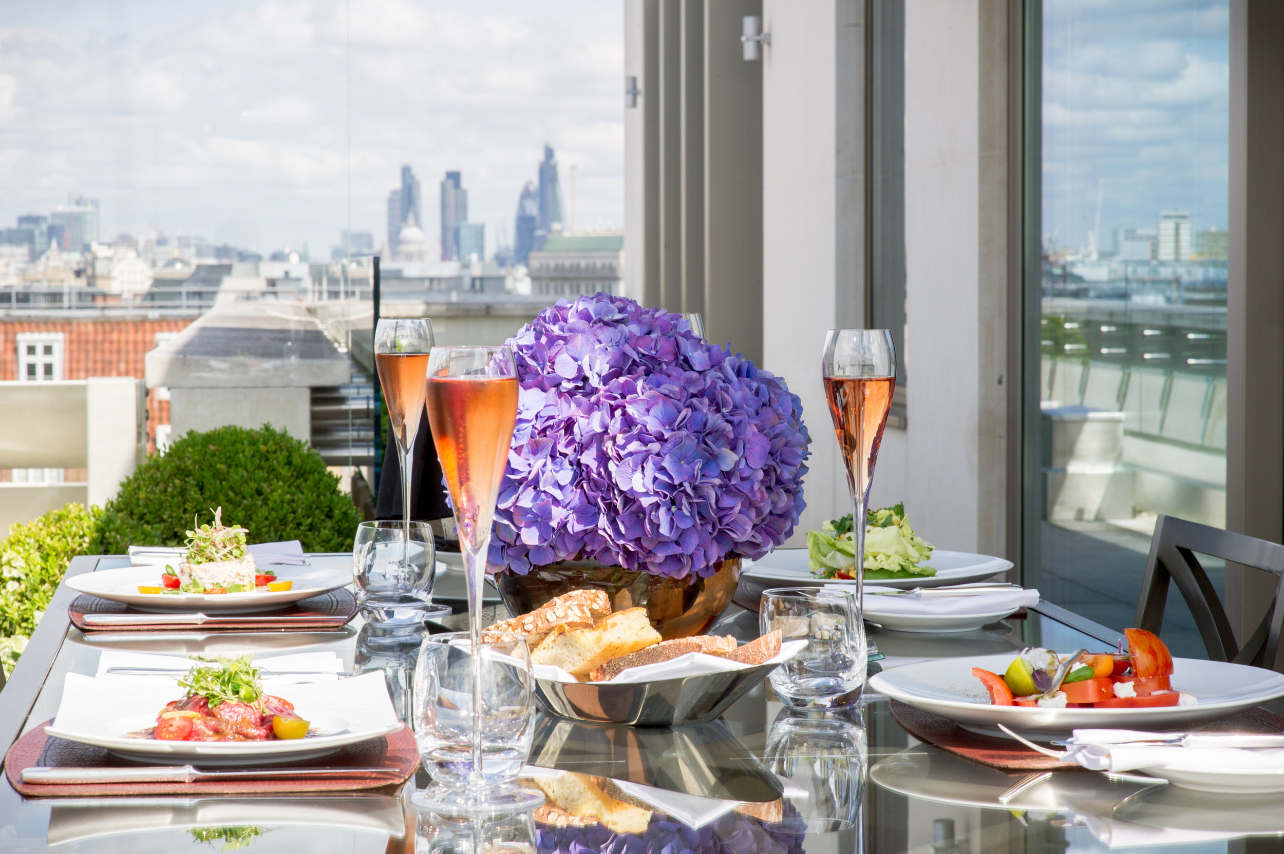 45 Park Lane - Penthouse Suite Terrace, set for private dinning (high res crop).jpg
