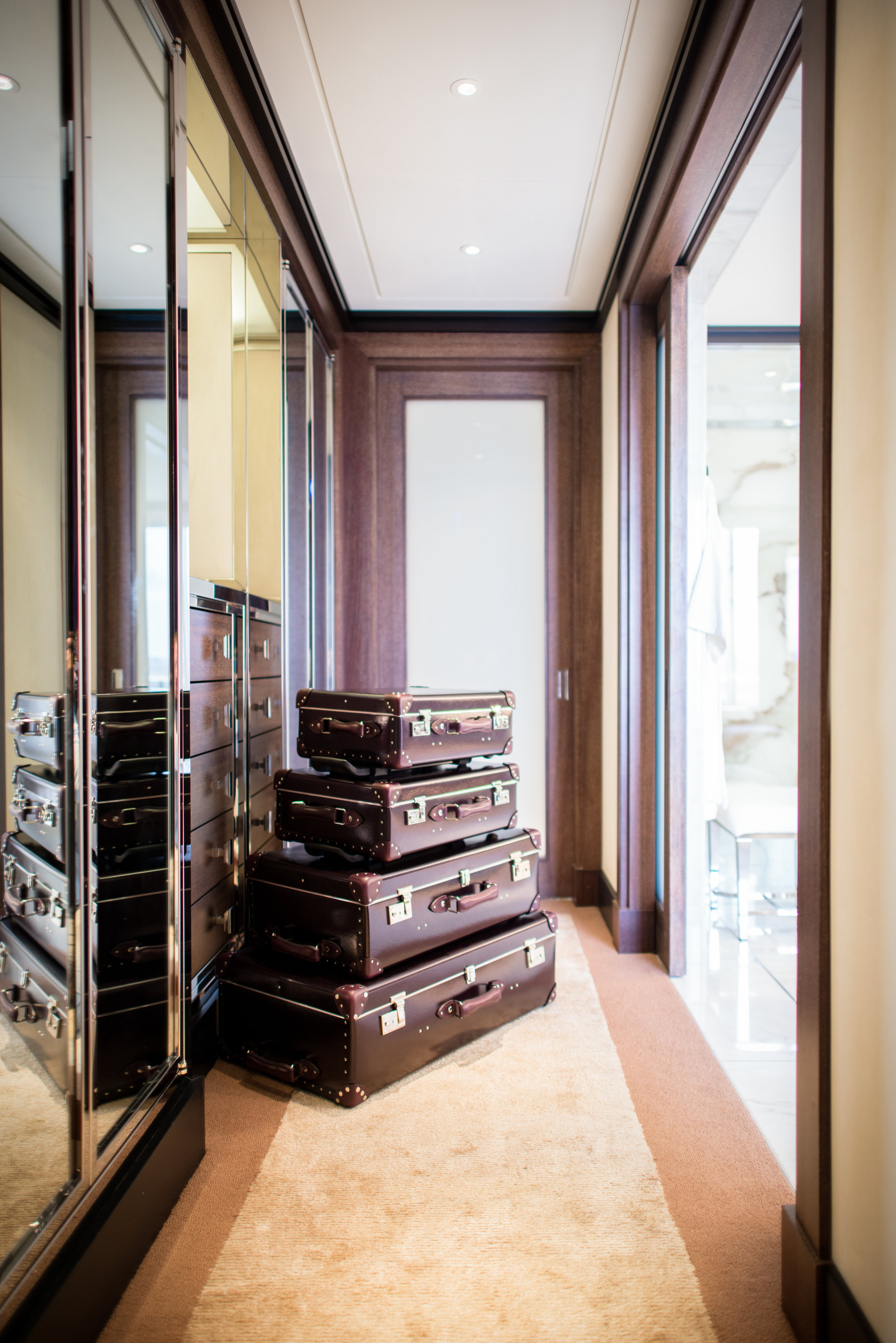 45 Park Lane - Penthouse Suite, wardrobe with luggage (high res).jpg