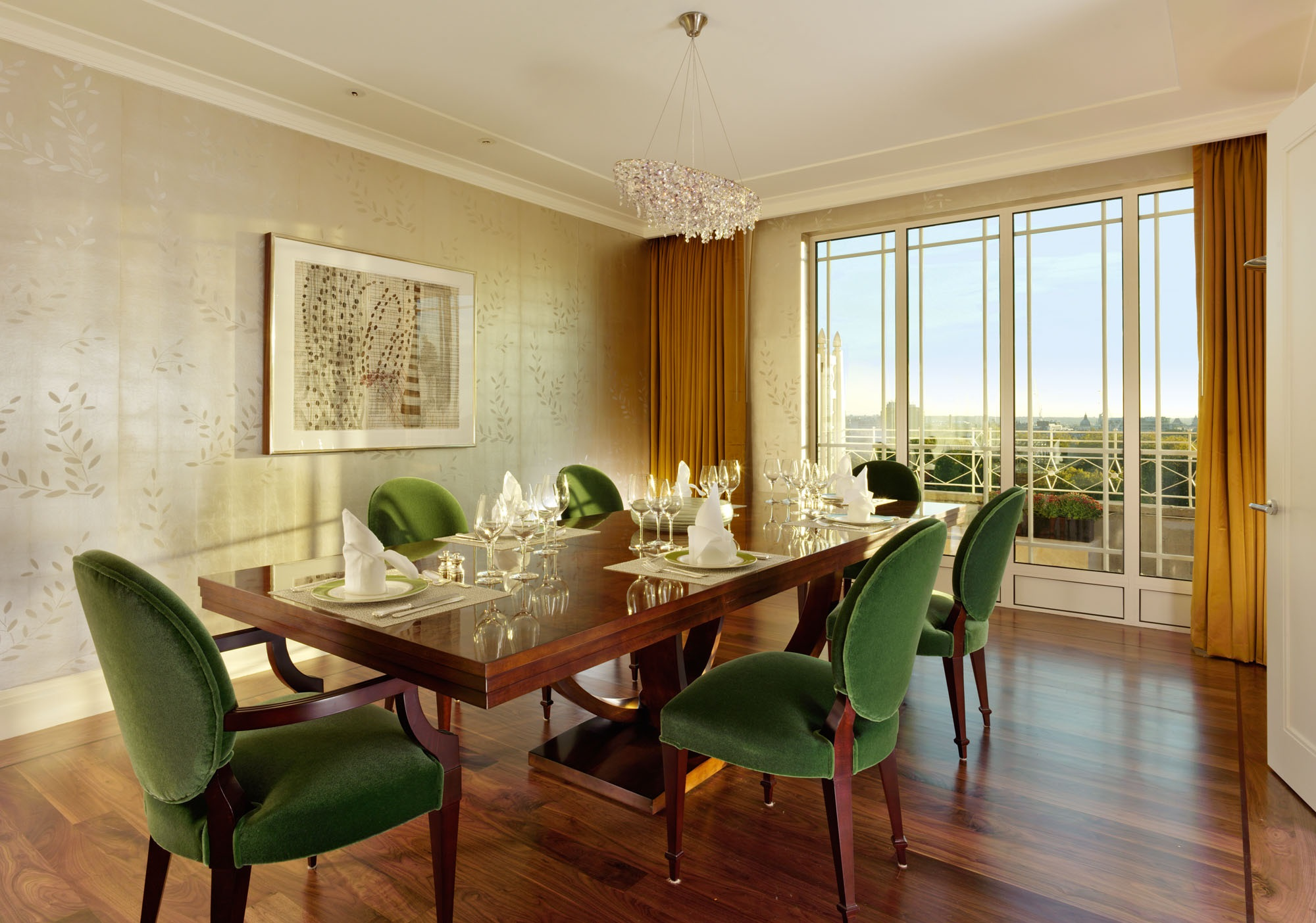 Hollywood Glamour - The largest penthouse suite at The Dorchester, The Harlequin Penthouse is made up of a master bedroom with an en-suite bathroom and dressing room, a dining room, living room, bar and large outside terrace overlooking Hyde Park. Two sets of French doors lead onto the terrace and flood the room with natural light. It was in this very room that Elizabeth Taylor received the news of her record-breaking, multi-million pound deal to star in the Hollywood epic Cleopatra and the suite still glows with Hollywood glamour. The dining room seats eight and features a bespoke crystal chandelier by Metalarté, echoing the fabled diamond collection of Ms. Taylor. The luxurious master bathroom features black Nero Marquina floors with under-floor heating, walls of book-matched white Arabescato Oro marble slabs, white onyx vanities and a large freestanding bath and a state-of-the-art shower toilet by Geberit. The Harlequin Penthouse is available as a two-bedroom suite and the second bedroom still has the original pink marble bathroom that was installed for Elizabeth Taylor.