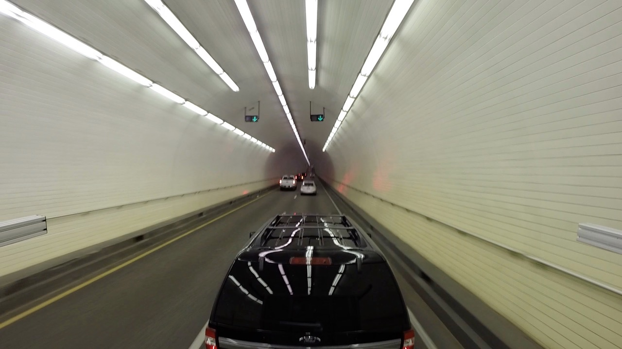 On I-10 in Mobile Alabama driving through the  George Wallace Tunnel .