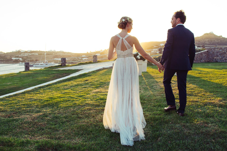 Bride and groom at sunset wedding ceremony, Santa Marina Resort in Mykonos, Greece