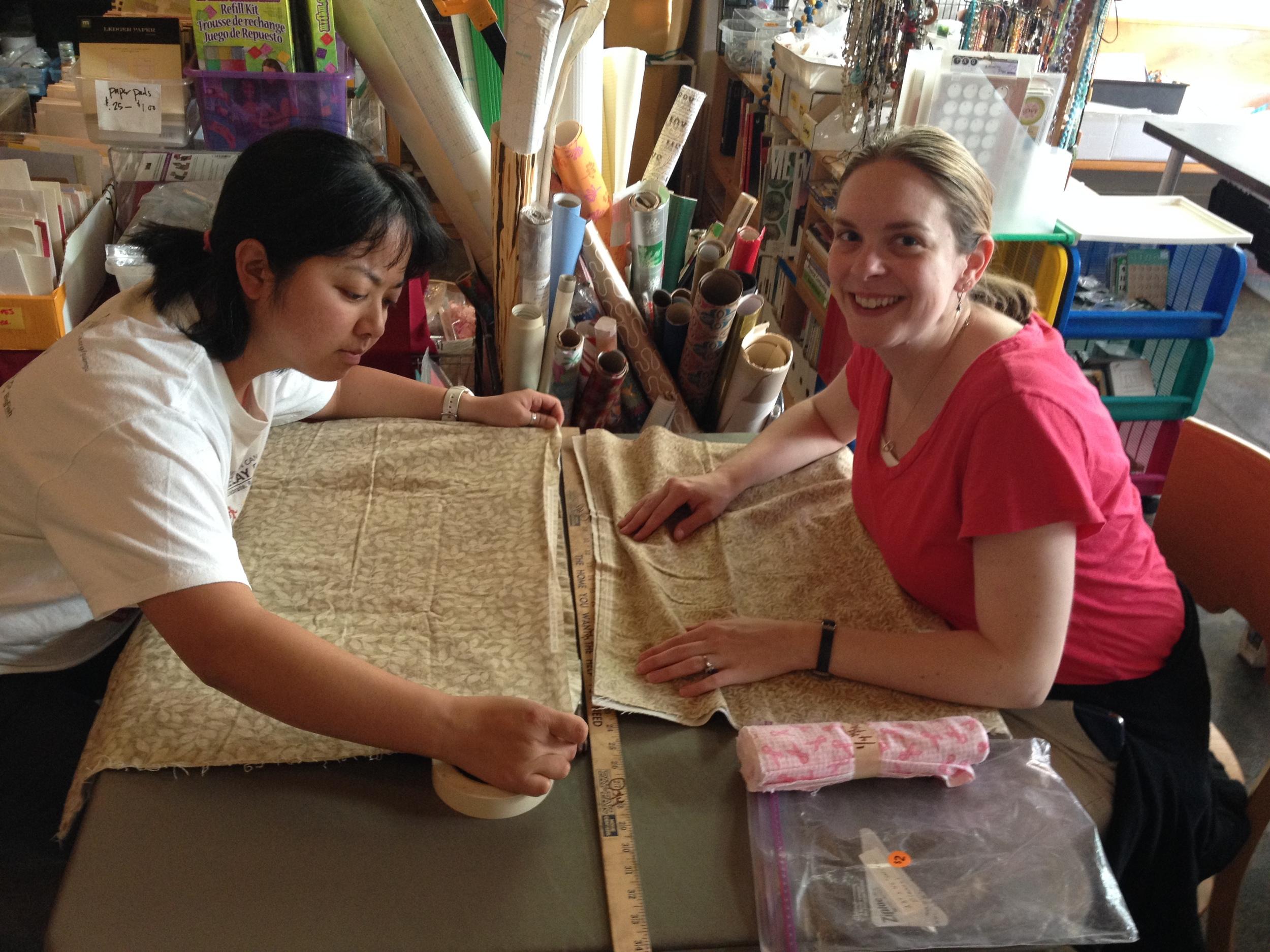volunteers measuring fabric.JPG