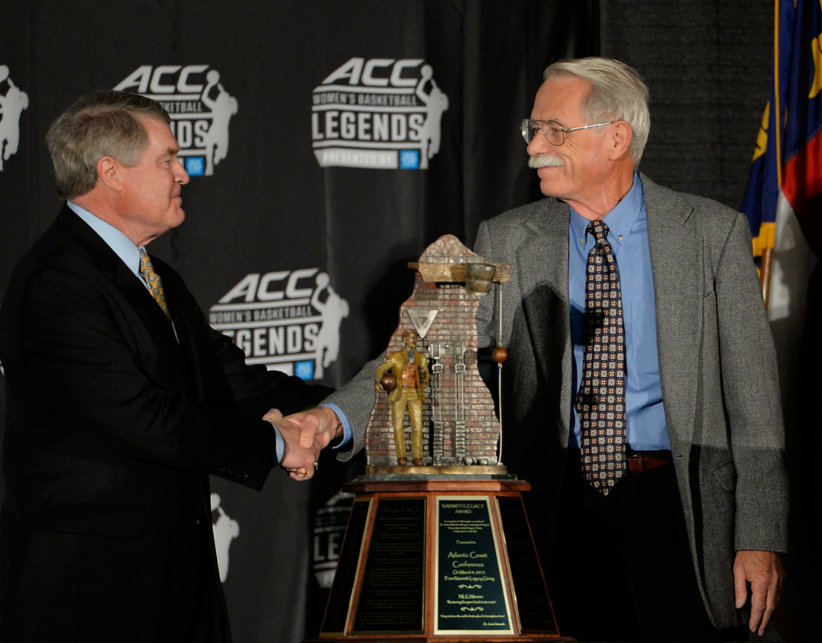 John S  wafford   (left),  ACC Commisioner, receives the Naismith Legacy Award from Jim Naismith, grandson of Dr. James Naismith.