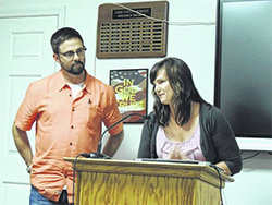 Ashe County School's Assessent, Support and Counseling Staff, including Dr. Kurt Michael, left, and Whitney Van Sant, address the Ashe County Board of Education on May 1.