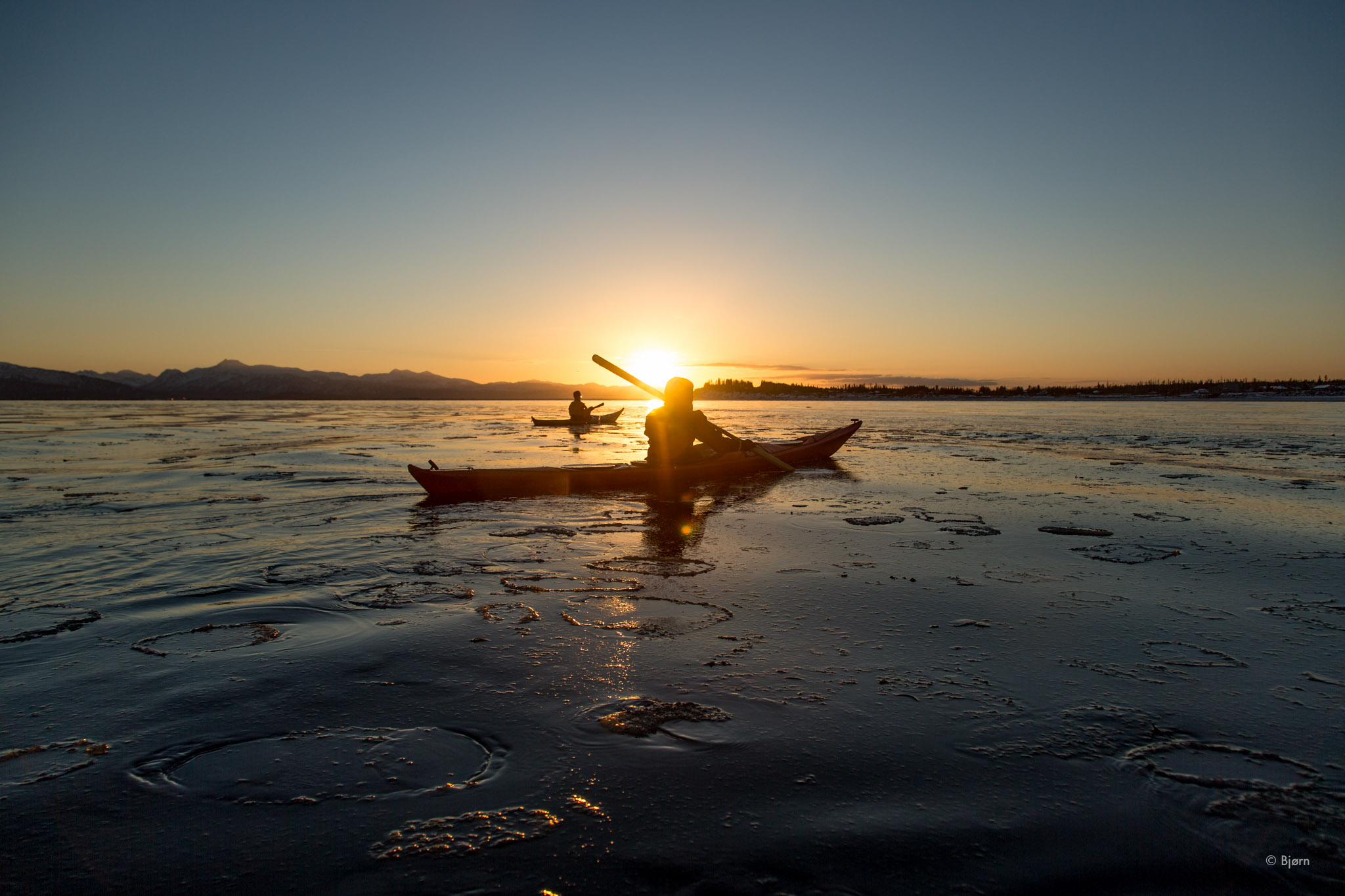 Kim and Hig Kayak Into Mid-Winter Sunset