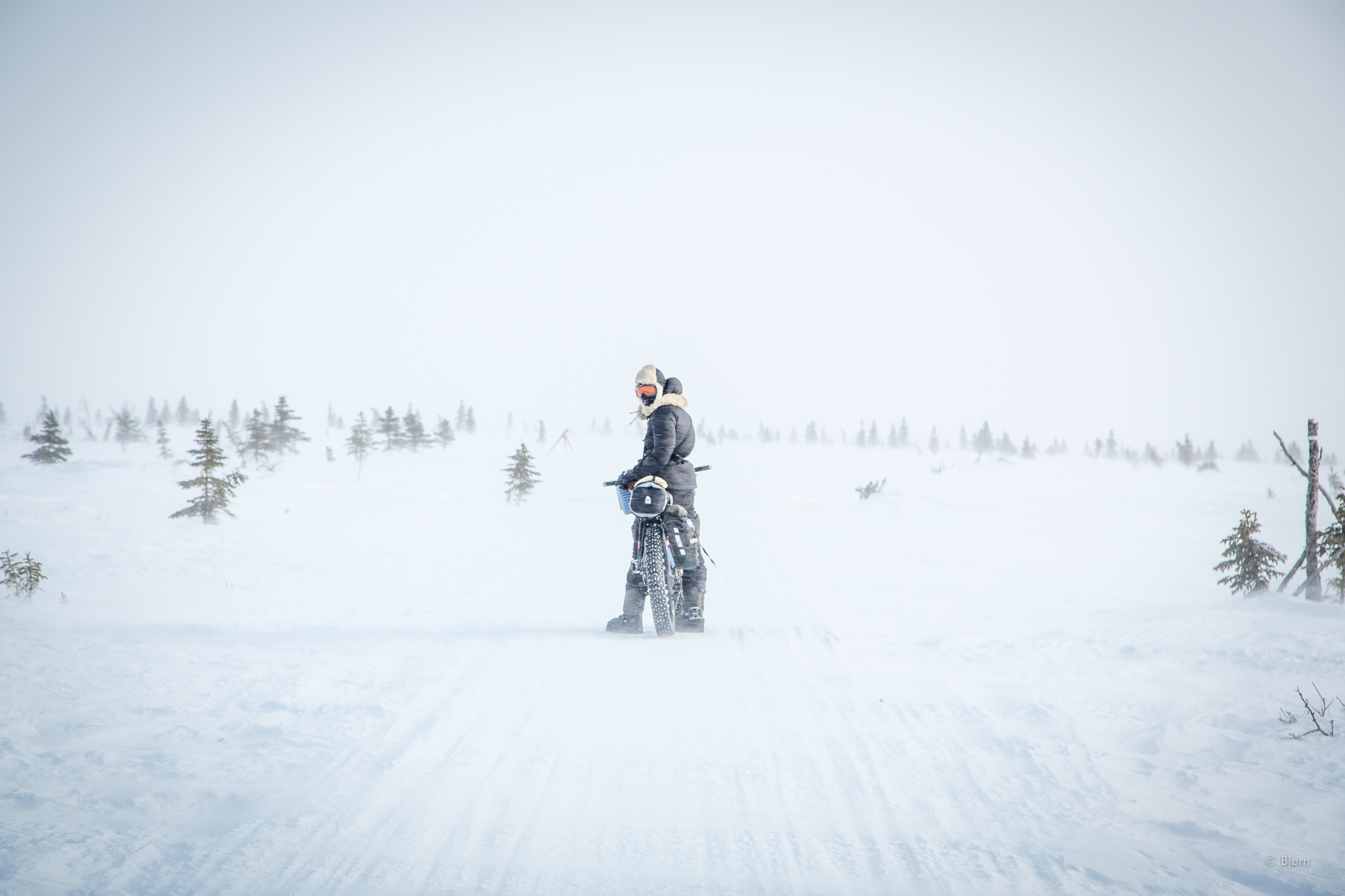 Kim McNett rides through a ground-blizzard on the Seward Peninsula. In the late winter of 2016, Kim and Bjorn cycled from Nome to Kivalina, Alaska.
