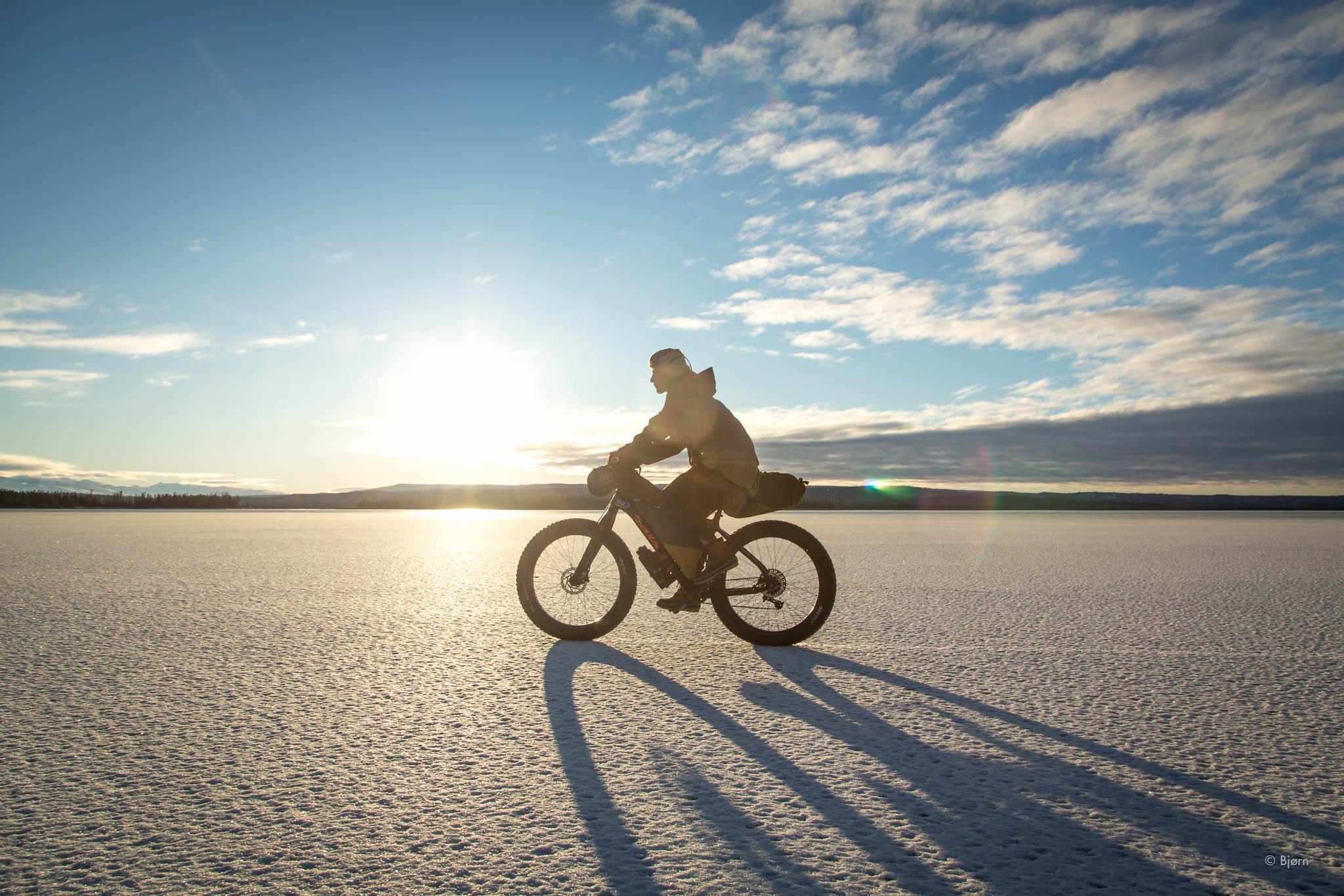 Kim rides the frozen Tustumena Lake.