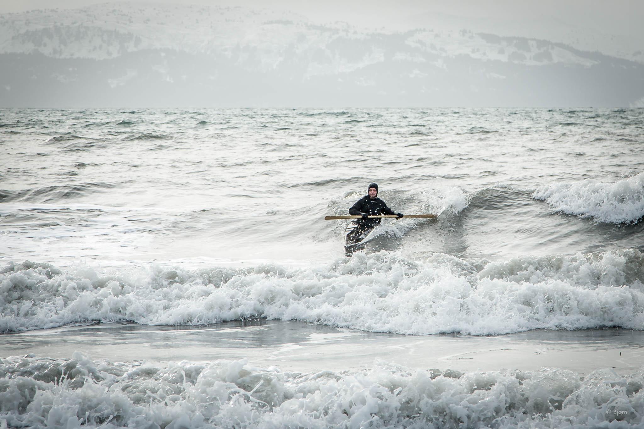 Bjørn surfing his traditional qayaq - Homer.