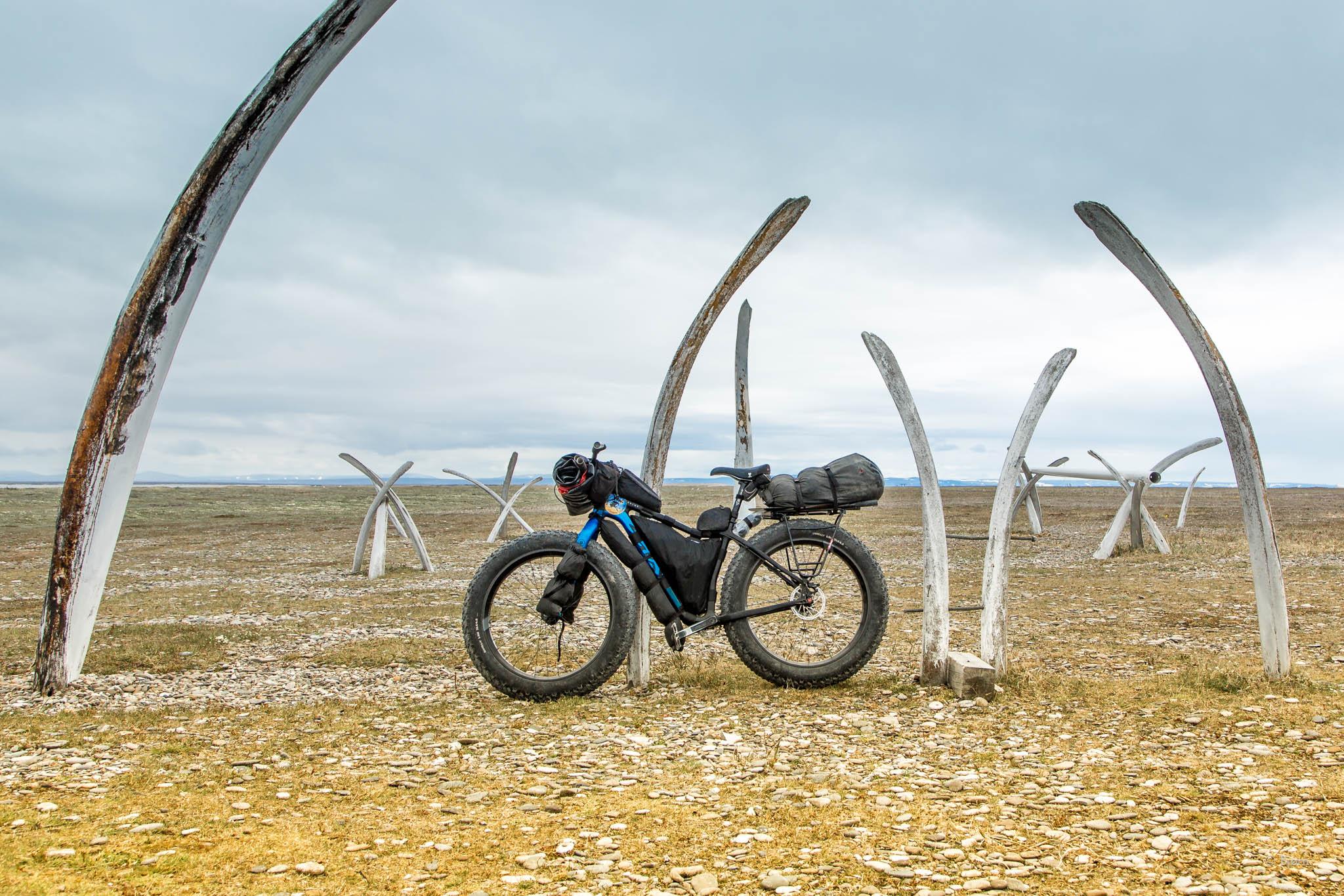 Salsa Mukluk fat-bike in front of whale bones - Point Hope, Alaska.