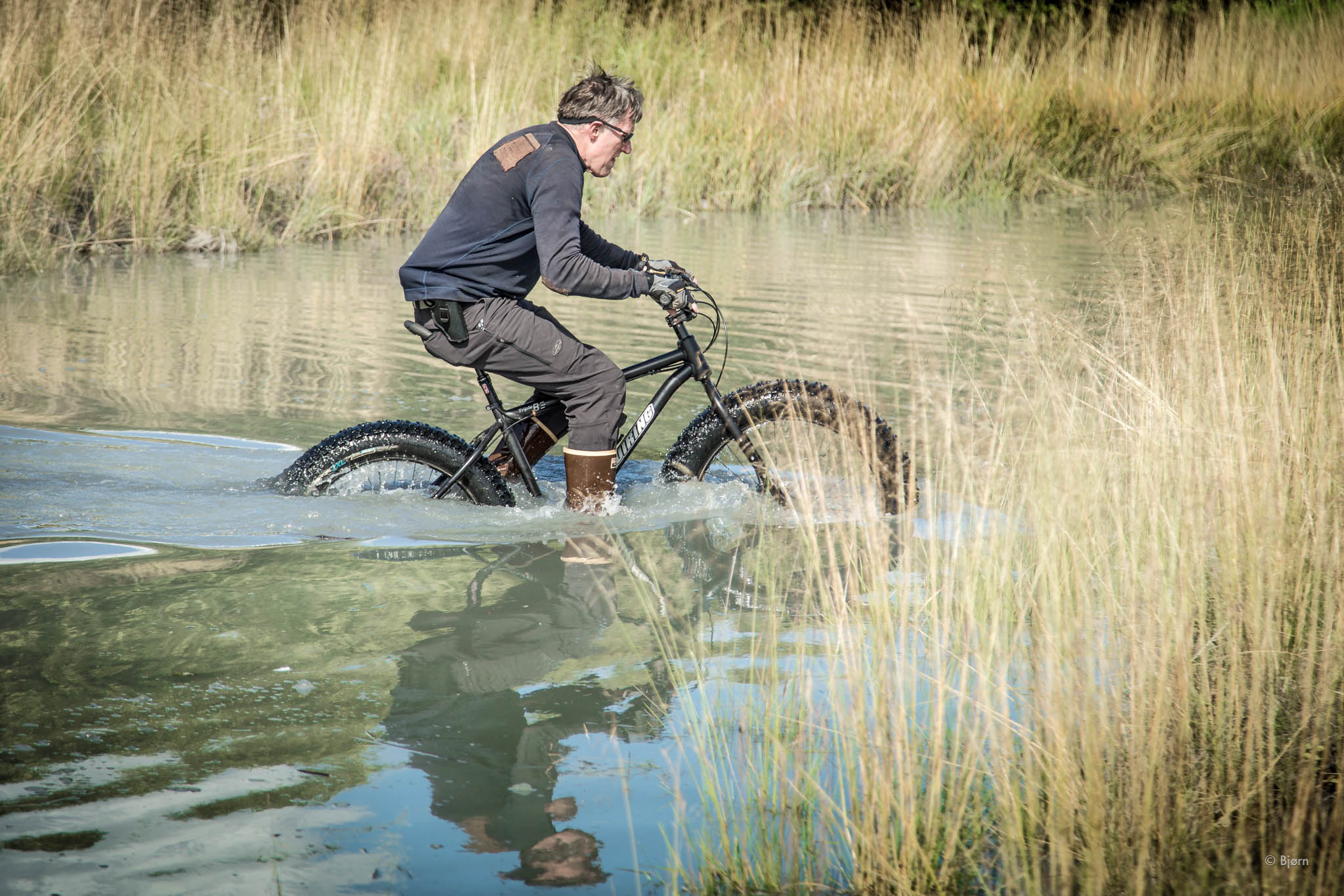 George rides through a deep creek - Seward, Alaska.