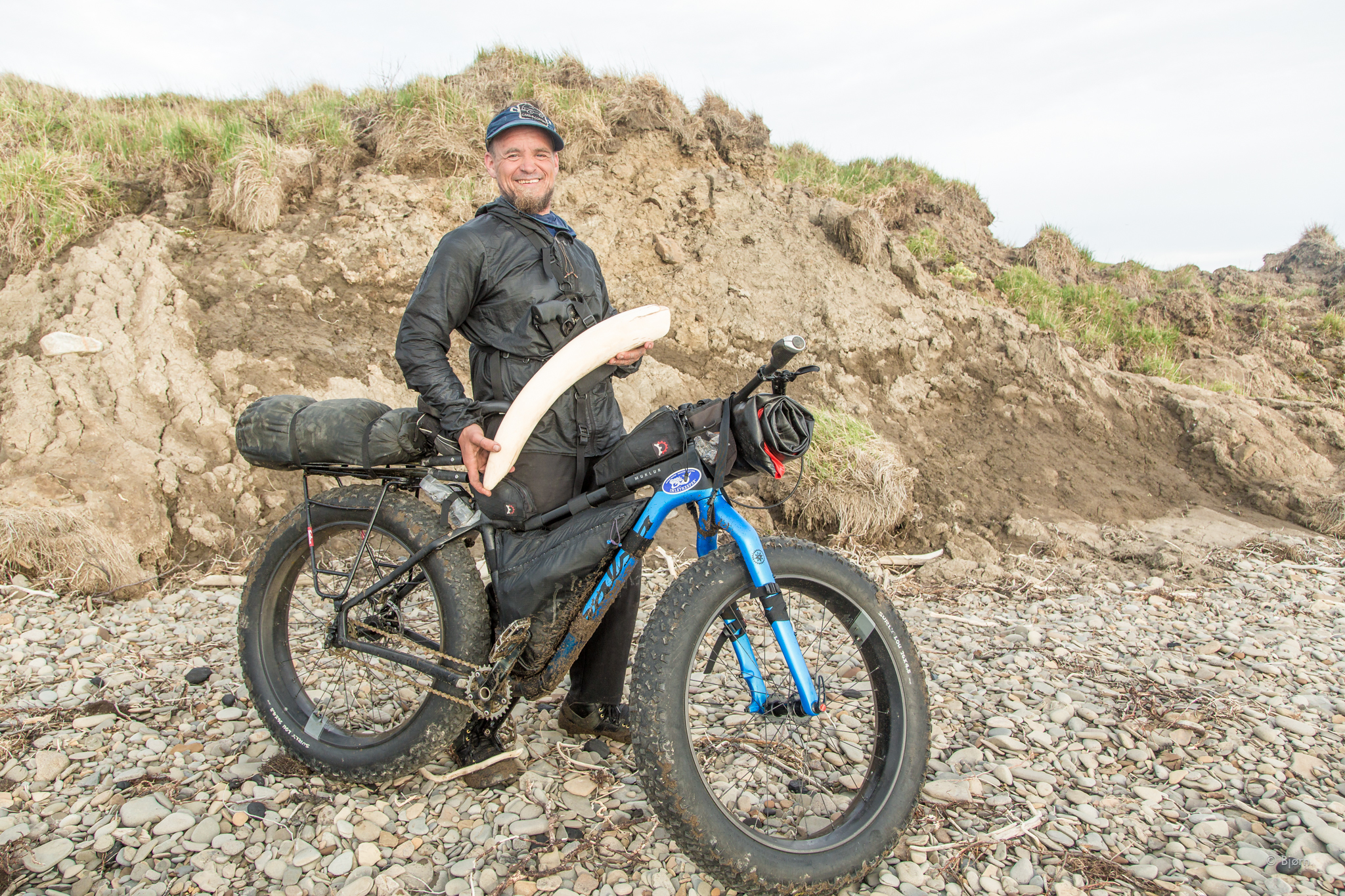 Bjørn poses with a mammoth tusk he found while riding his Salsa Cycles Mukluk fat-bike in the Arctic of Alaska.