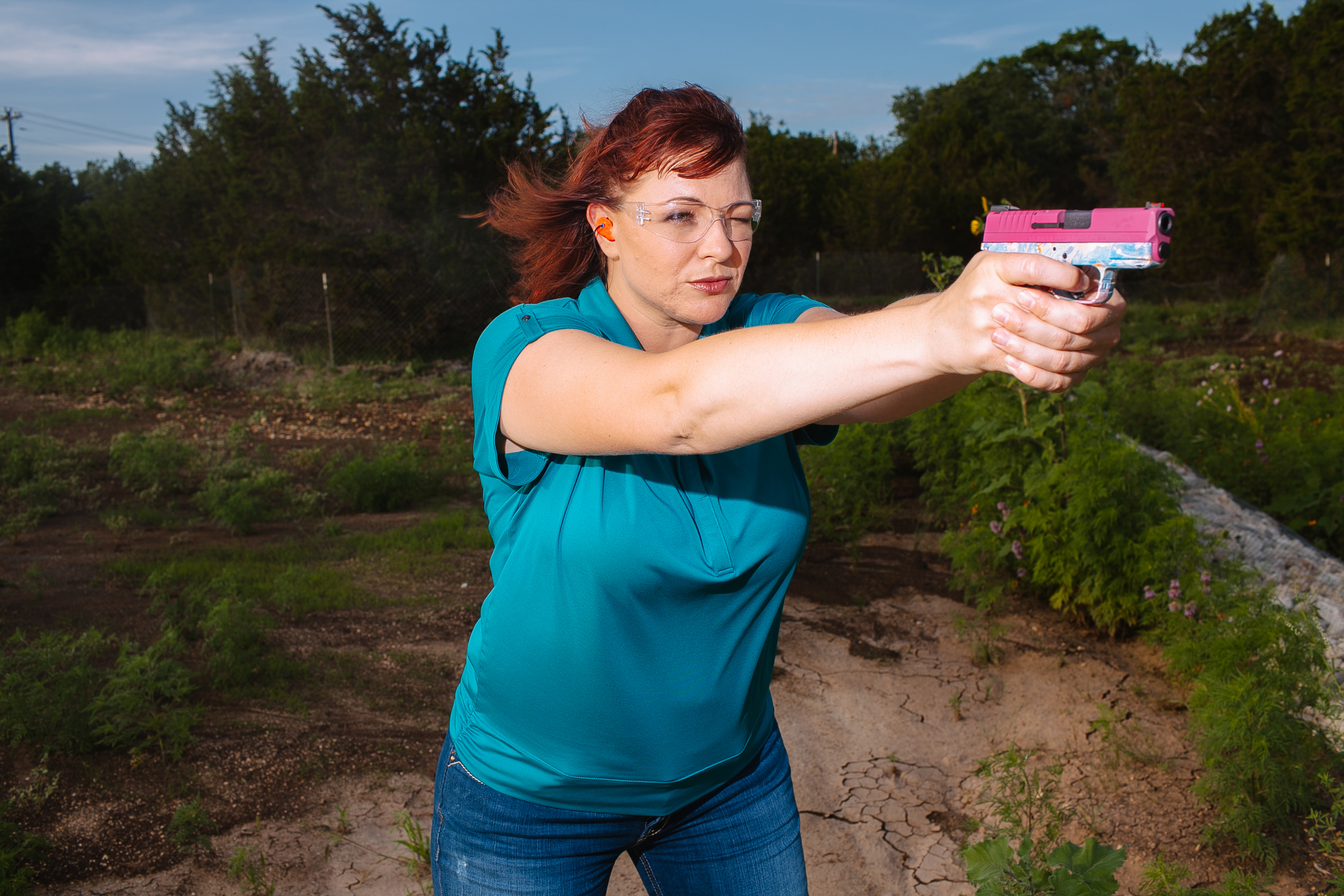 Julianna Crowder, director and founder of A Girl And A Gun, demonstrates proper and safe gun use with an unloaded concealed handgun designed in a floral print at the Shady Oaks Gun Range in Austin, Texas.