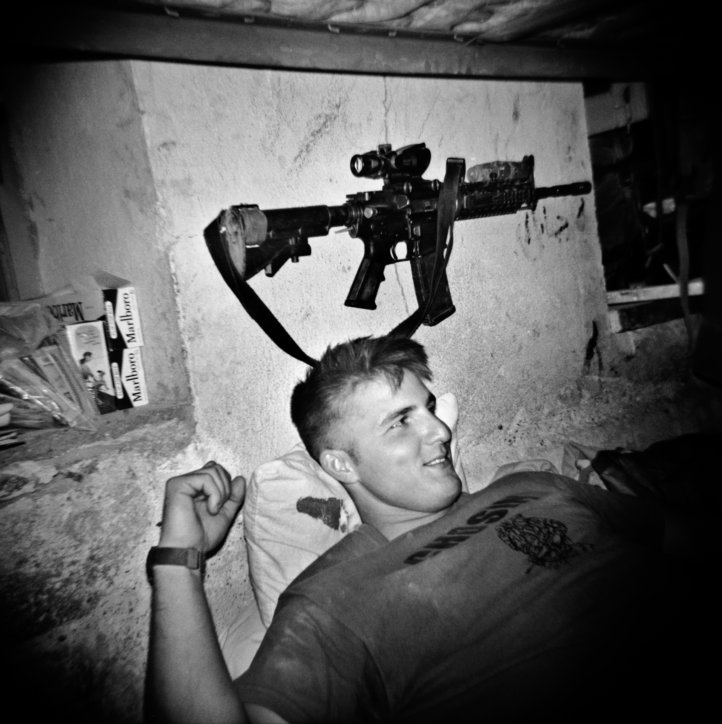 SGT Michael Irwin relaxes on his bed at a COP Charkh in Logar Province.