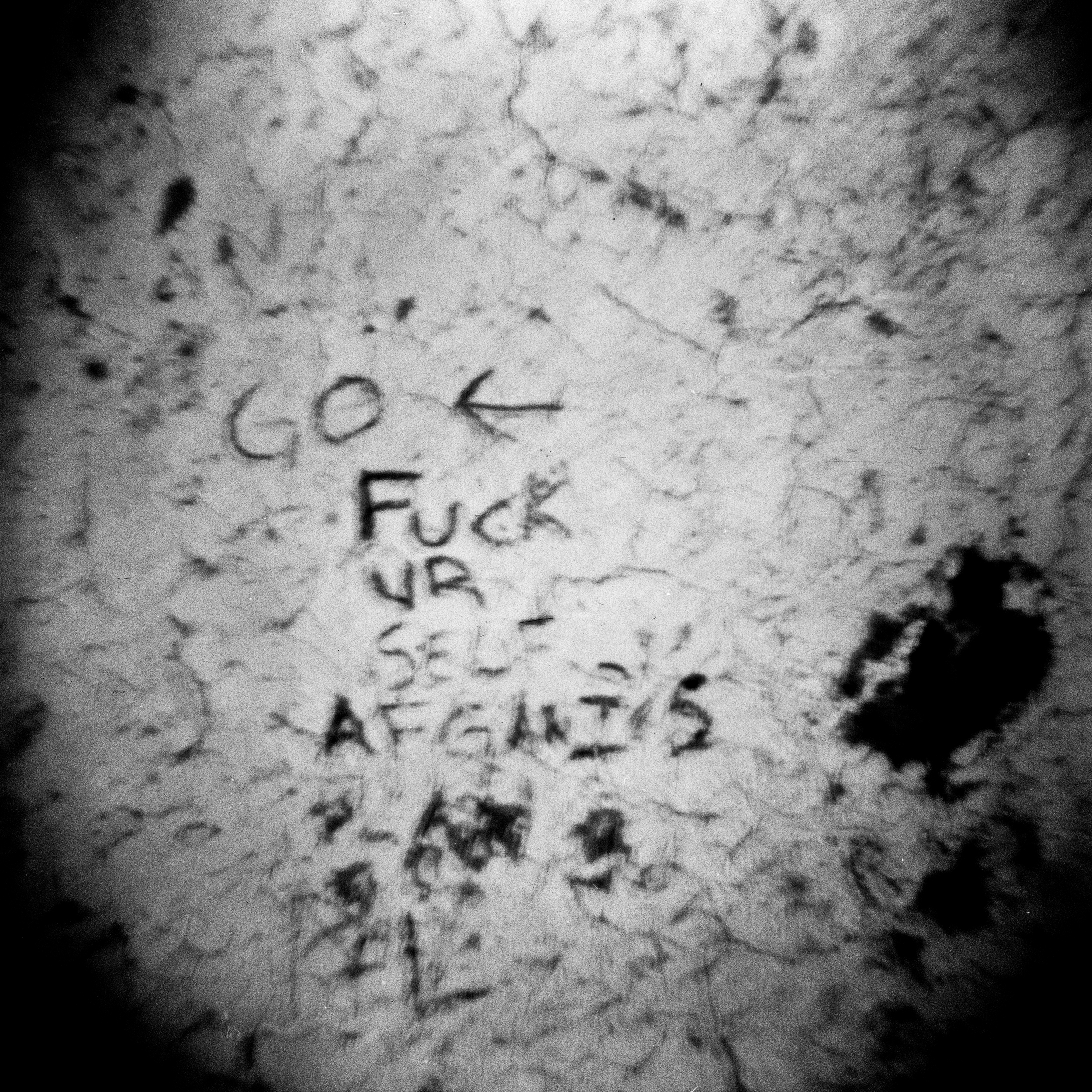 Graffiti scratched in to the side of a dirt wall by a US infantry soldier in Wardack Province, Afghanistan.