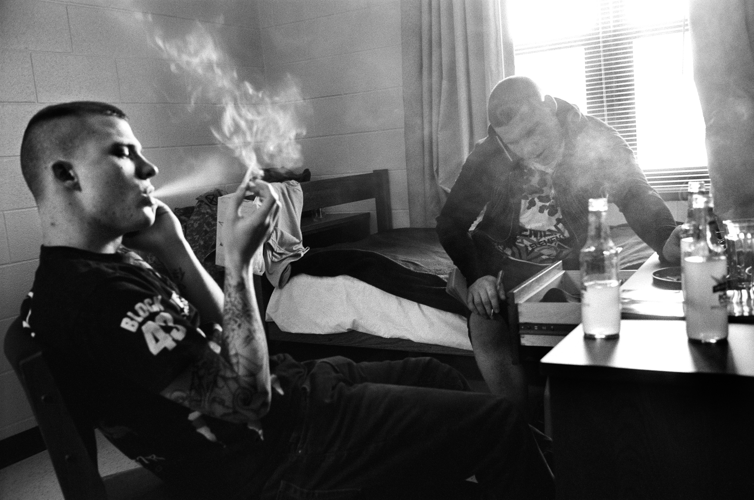 SPC Ryan Cooley and SPC Adam Ramsey smoke cigarettes in the barracks at Fort Drum, New York, 2010.