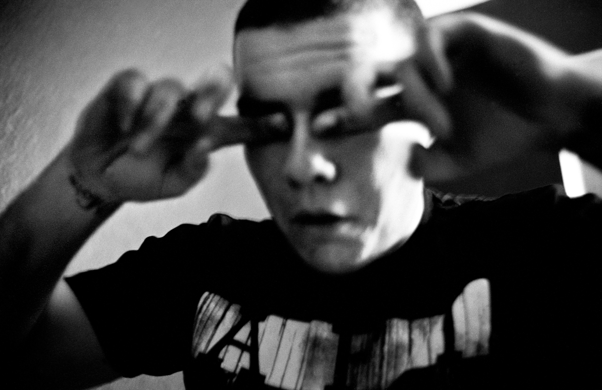 SPC Adam Ramsey rubs his eyes after having an anxiety attack at his sister's house in Carson City, Nevada, 2010. While on leave in Nevada Ramsey experienced hallucinations, depression, and suicidal thoughts; he self-medicated by mixing prescribed medications with alcohol, a common practice among soldiers with post-deployment anxiety.