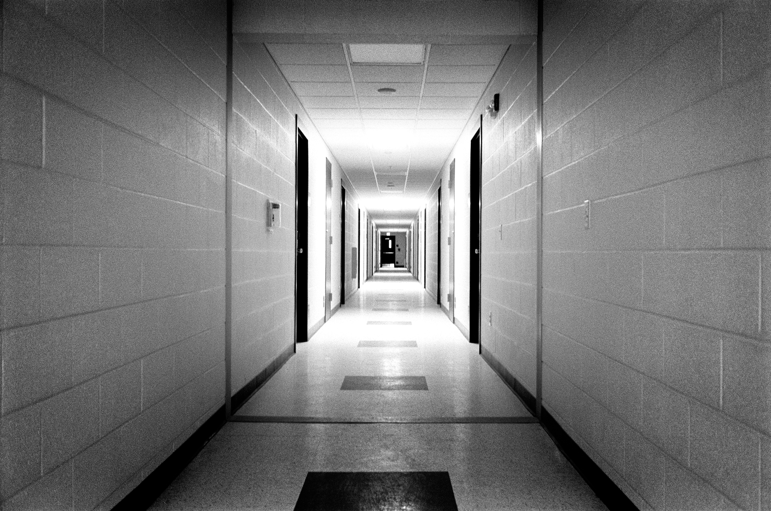 The barrack hallways stand deserted while soldiers are on leave; Fort Drum, 2010.