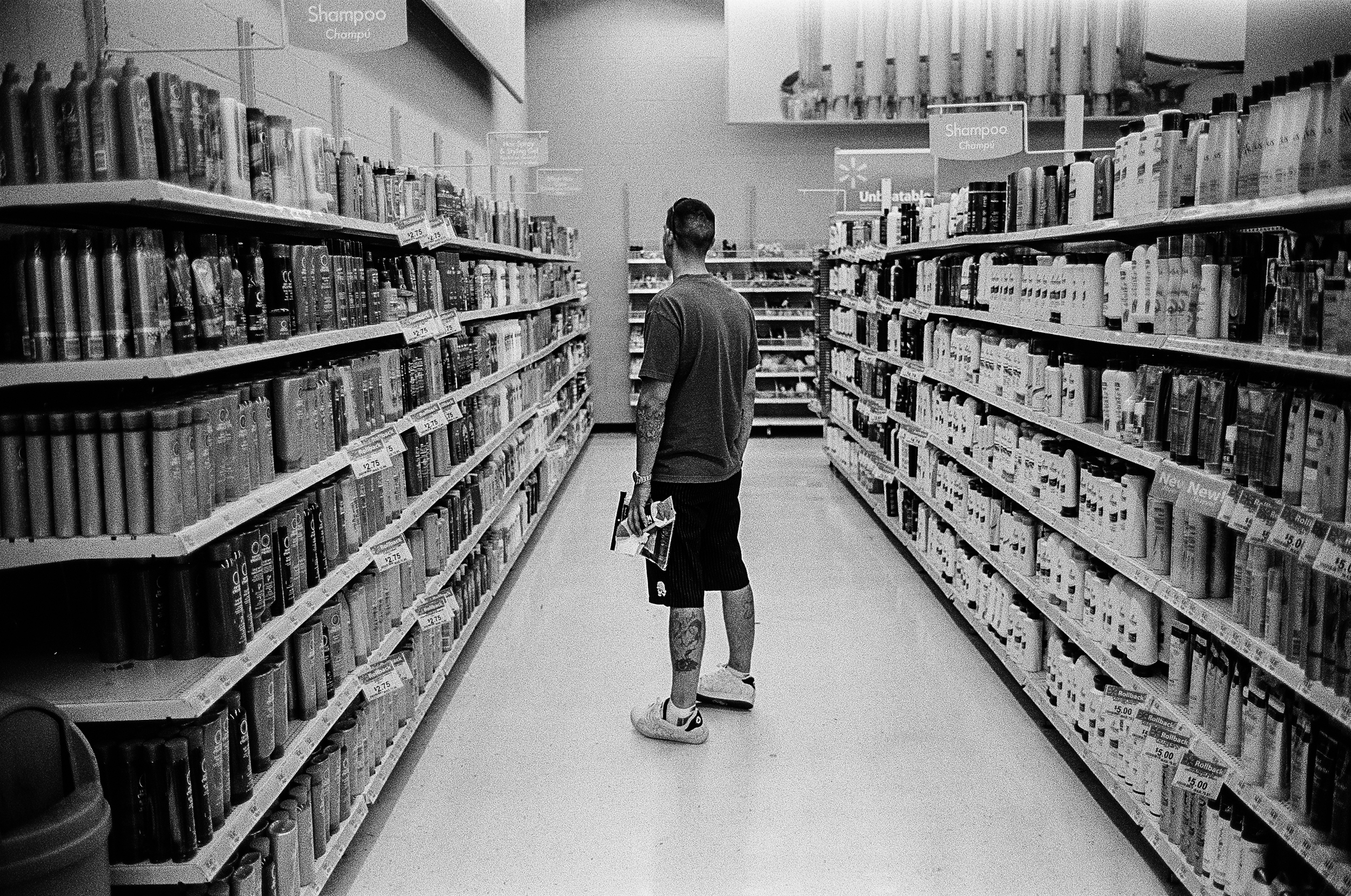 Veteran William Martinez is overwhelmed by the choices of products during his first visit to a Walmart after returning home from serving 12 months in Afghanistan; Corpus Christie, Texas, 2010. Martinez can only stay in stores for a few minutes before undergoing an anxiety attack.