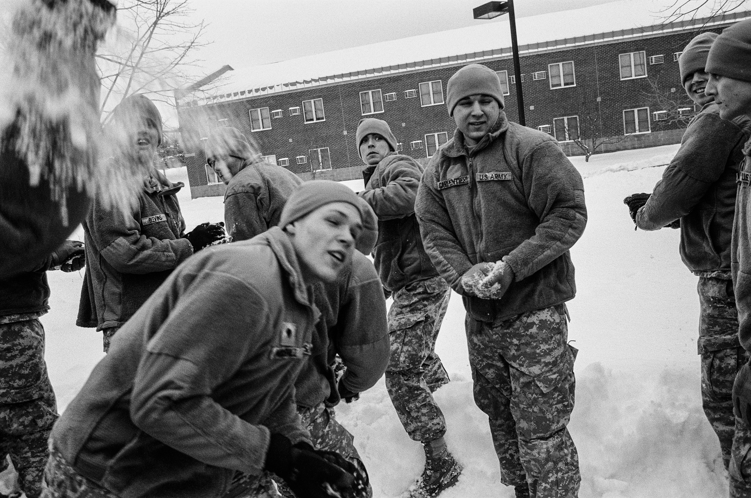 Soldiers of Bravo Company, 1-32nd Infantry Regiment have a snowball fight after being released for the weekend at the 10th Mountain Division base, Fort Drum, New York, 2010.