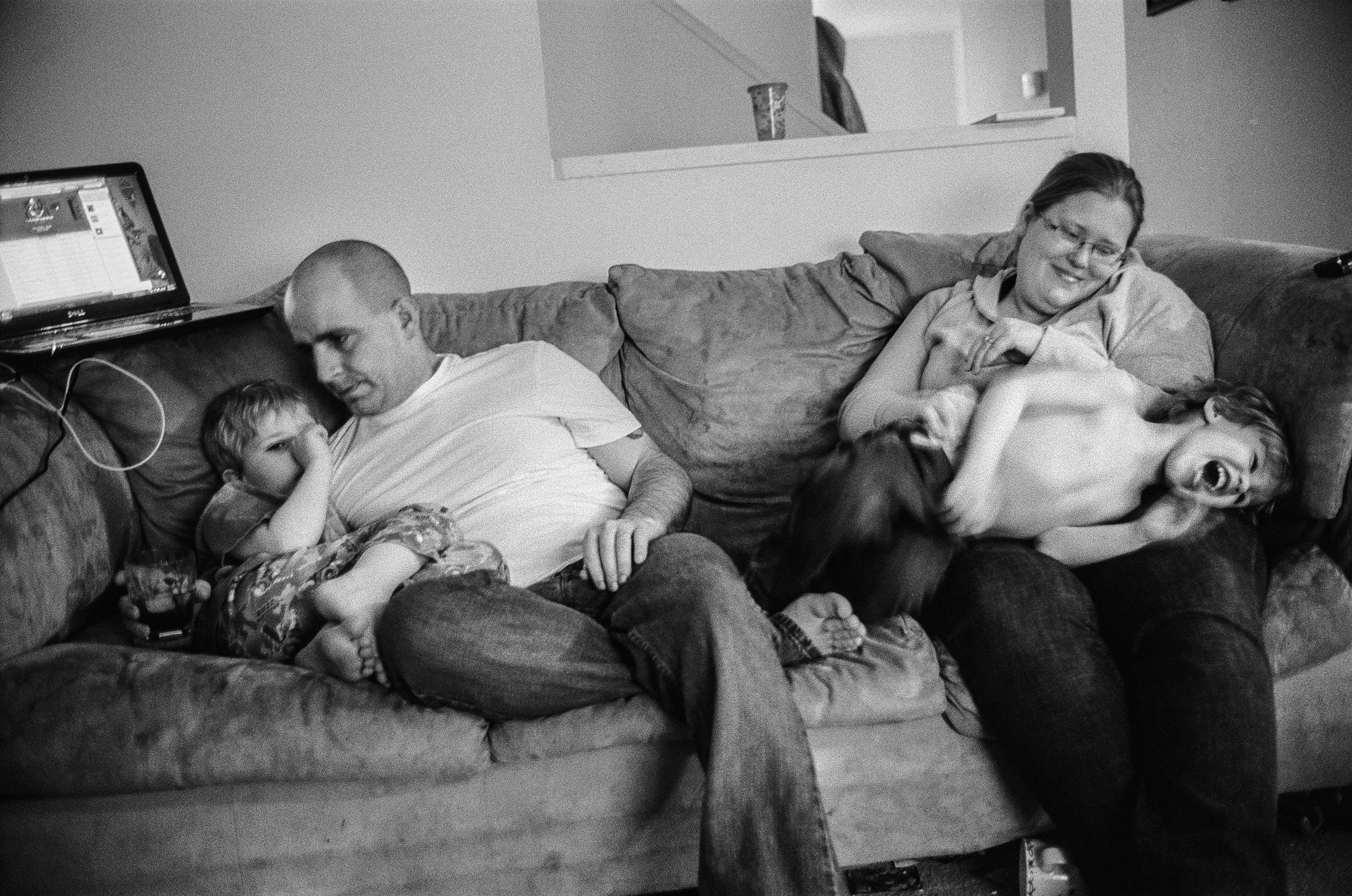 SPC Matthew Ledford sits at home with his wife, Scarlett, and their children at Fort Drum, New York, 2011. Ledford suffers from PTSD and anxiety.