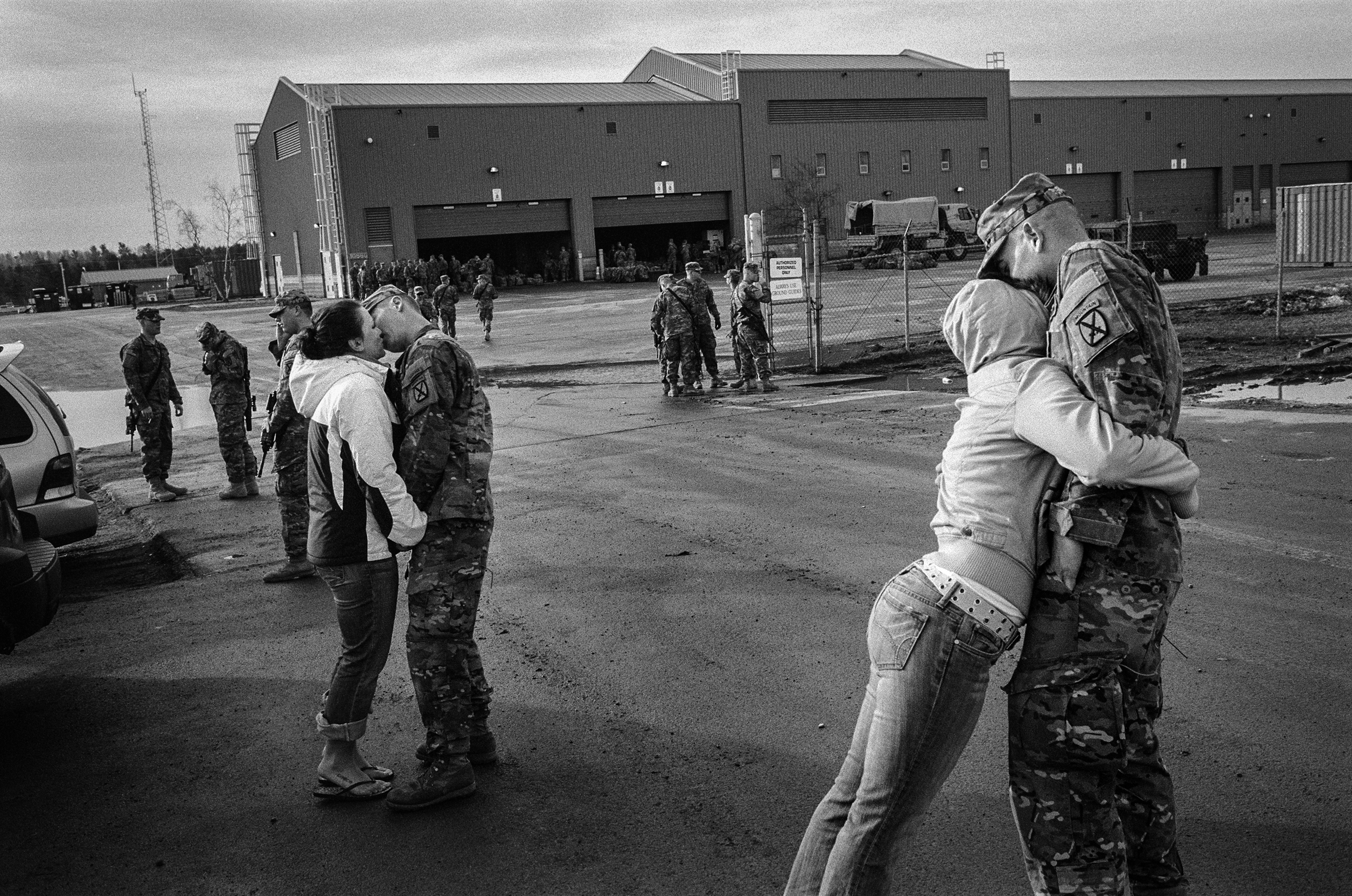 Soldiers say goodbye to their wives before deploying to Afghanistan at Fort Drum, New York, 2011.