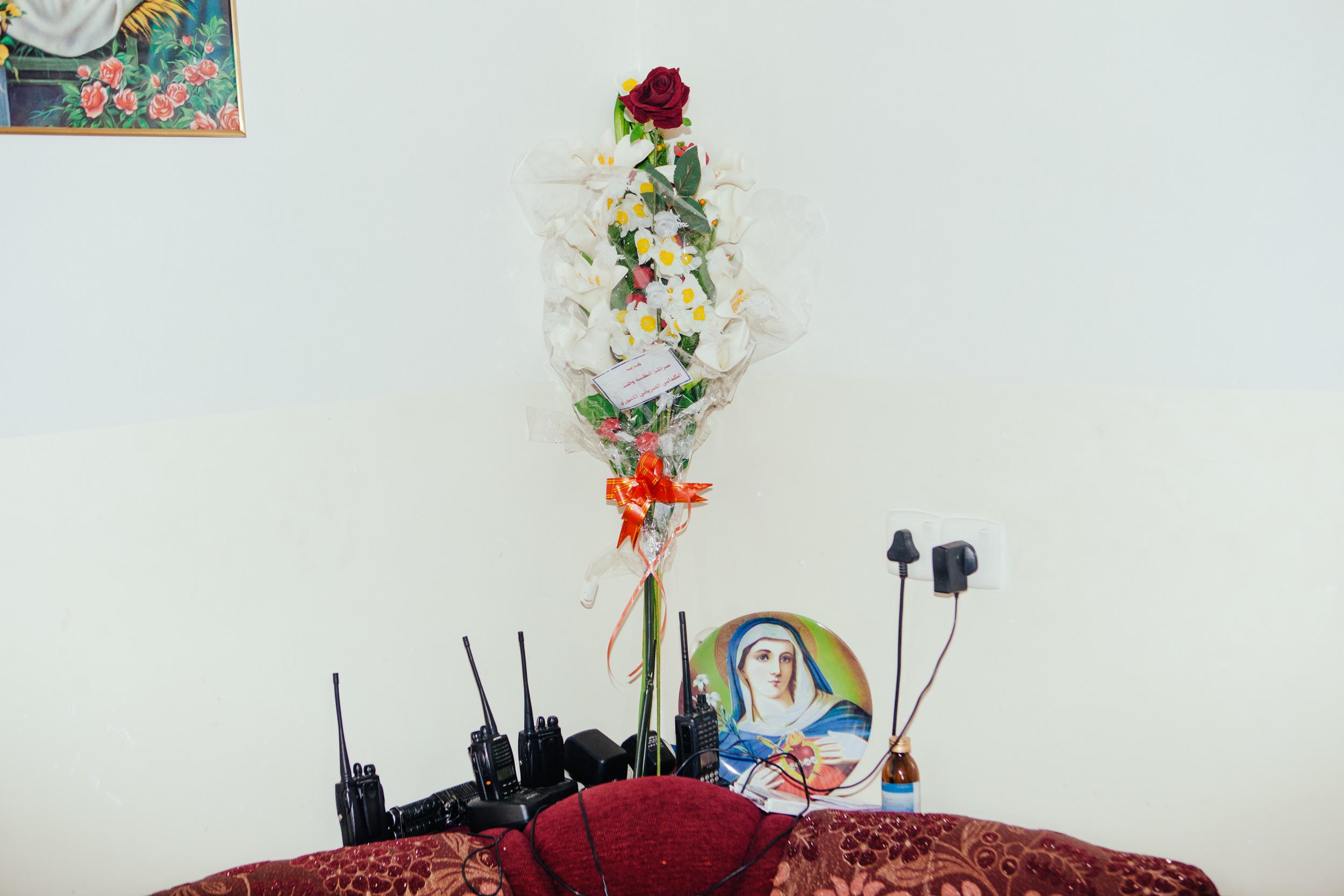 Flowers and radios adorn the walls at a Dwekh Nawsha military base near Baqofah,Northern Iraqi Kurdistan.