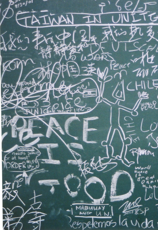 Visitor contributions on the Gun Sculpture exhibits blackboard at the United Nation, NYC