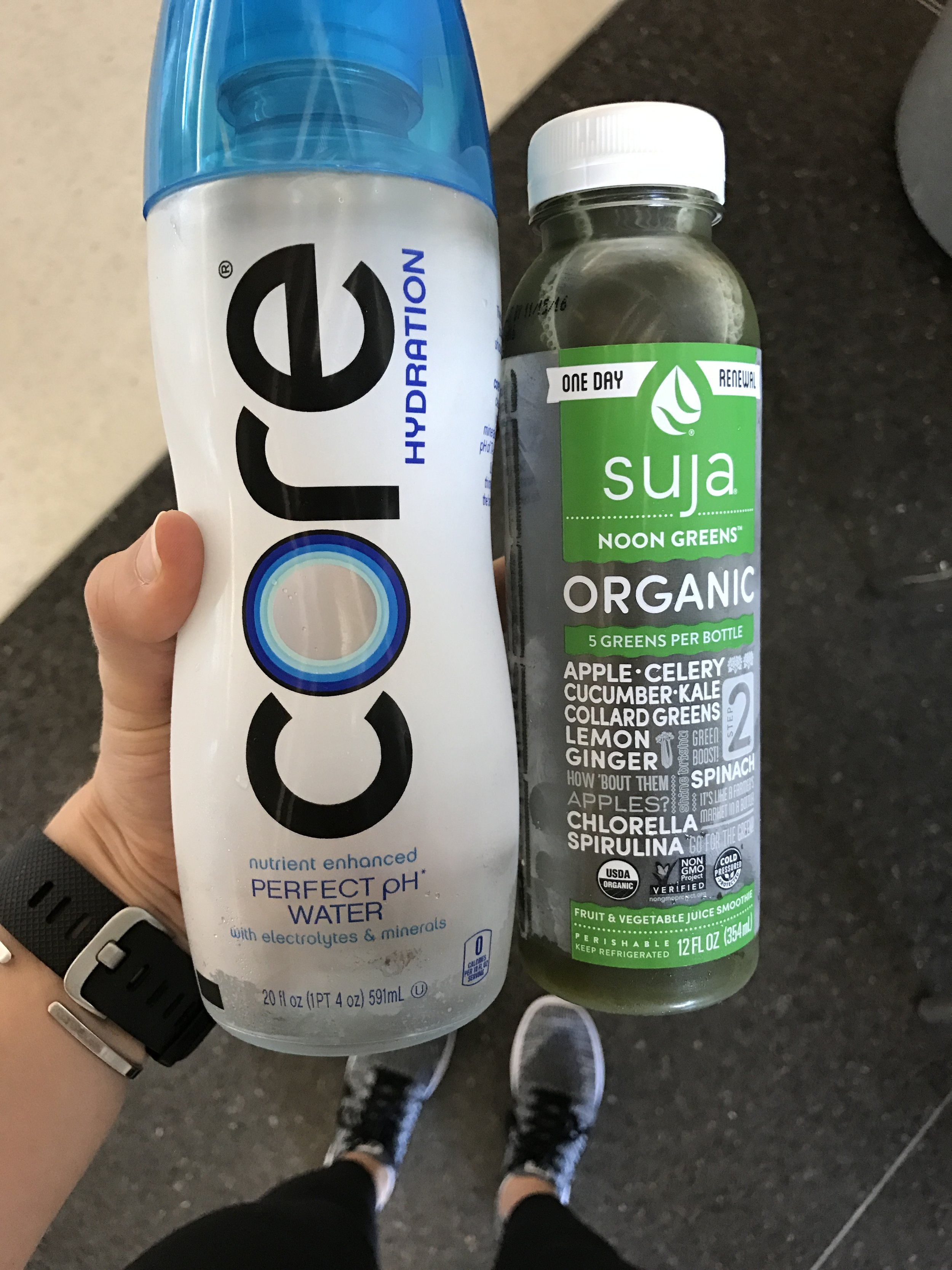Taking care of myself while traveling - green juice for nutrients, LOTS of water, and getting ALL the steps while in the airport.