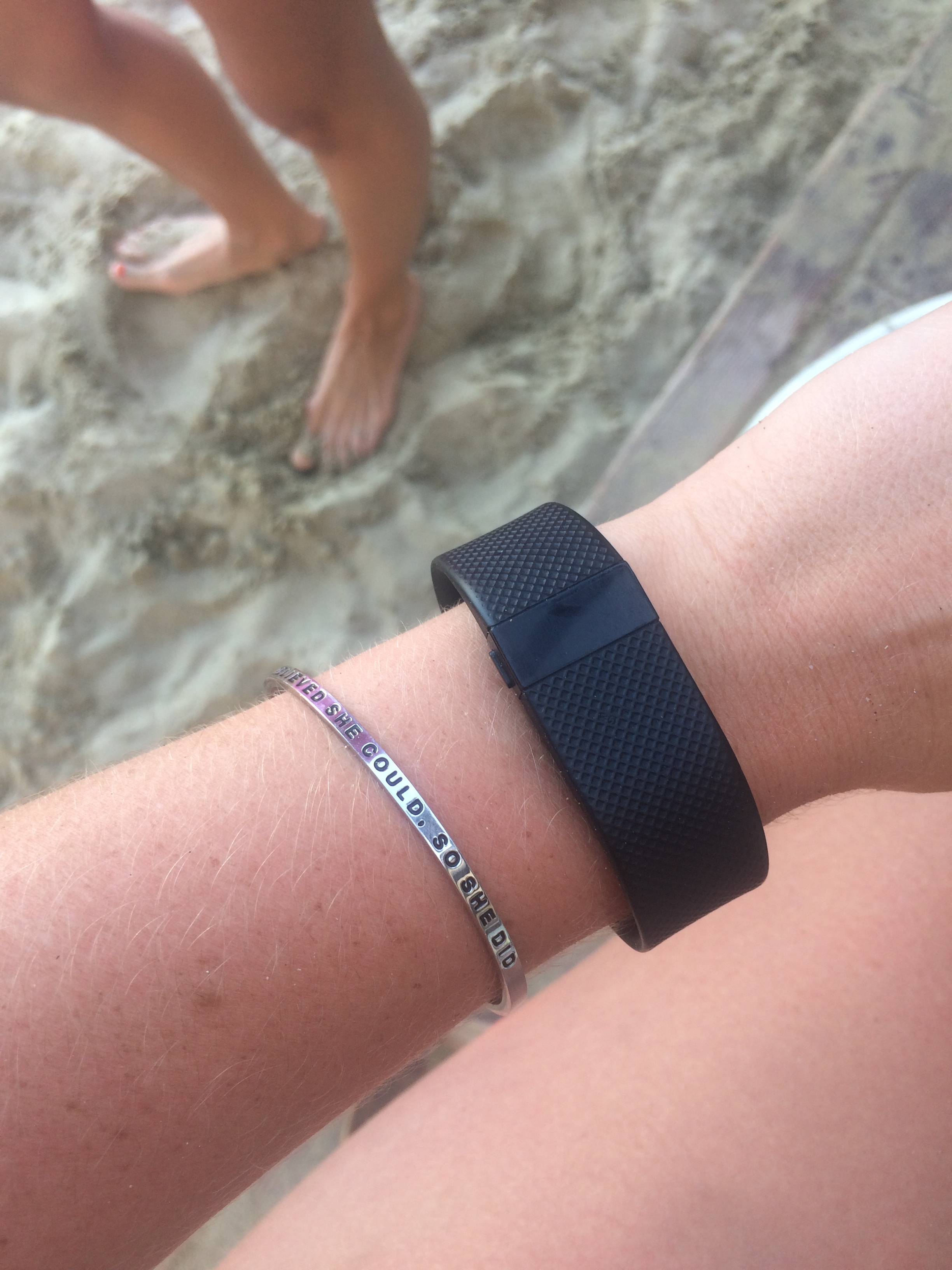 "On the beach with my amazingly fitting Mantra Band: ""She believed she could, so she did."" (love)"
