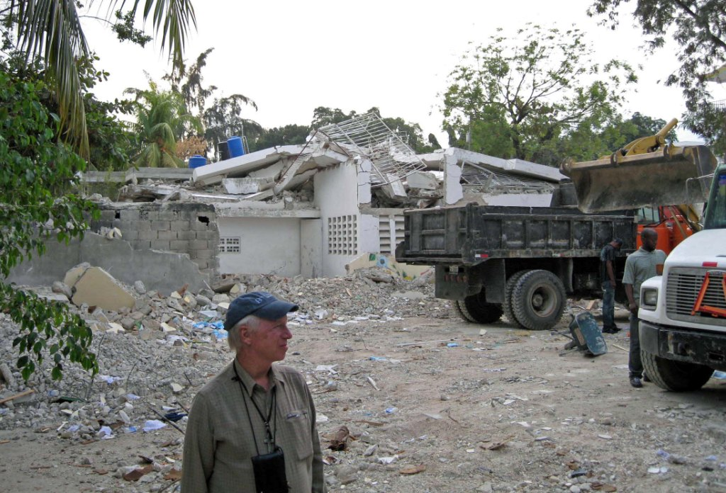 Fr. Tom views the cleared away rubble from the residence.