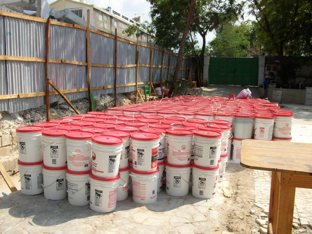 Buckets filled with food at our compound being readied for distribution to families living in nearby tent cities