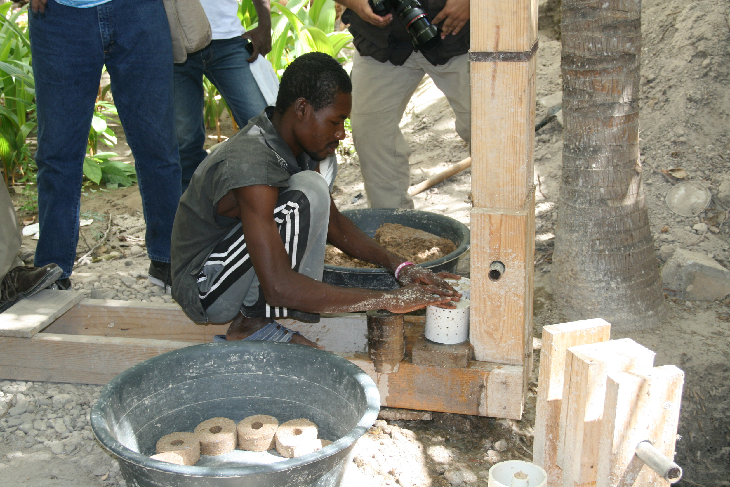 Making the briquettes from recycled trash