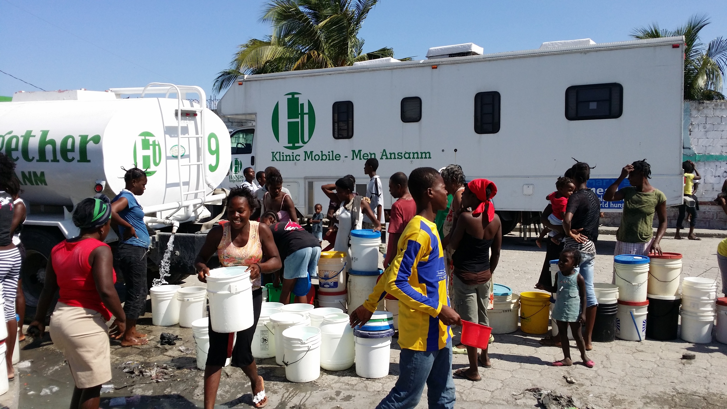 HT Mobile Medical unit and water truck provide help to residents of Cite Soleil.