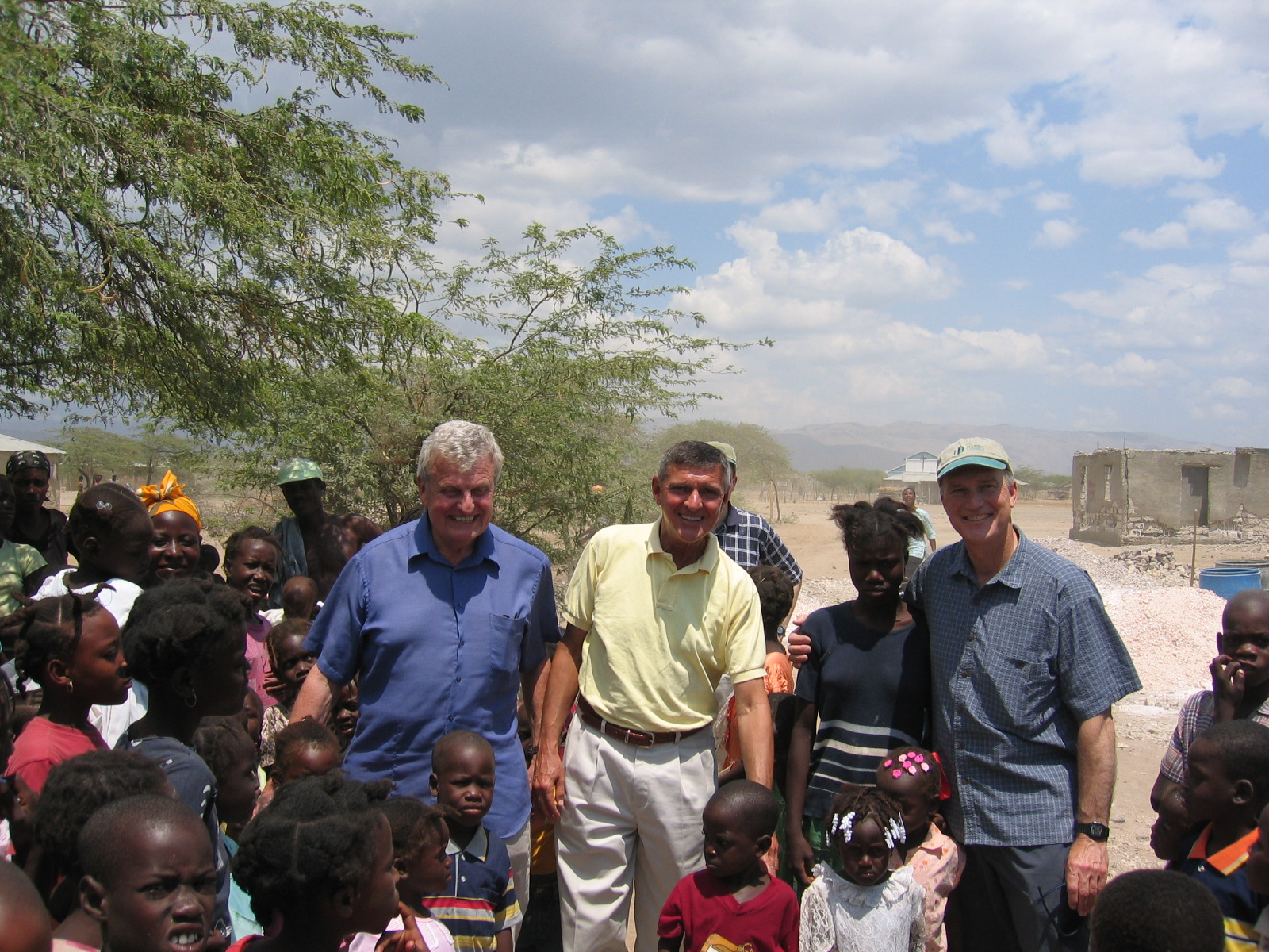 l to r: Paul Sigmund with fellow HT trustees, Tom Gilligan and John Clarke visiting our school in Ti Desdunnes Haiti.