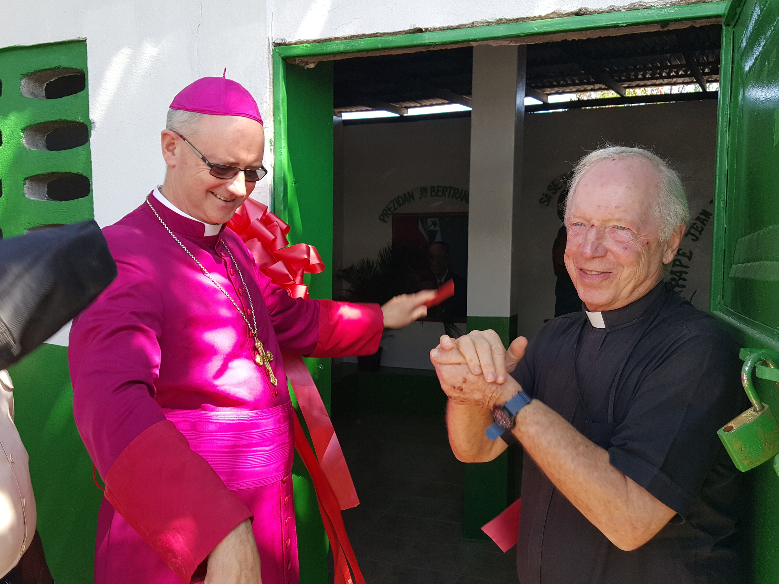 Ribbon Arch & Fr Tom.jpg