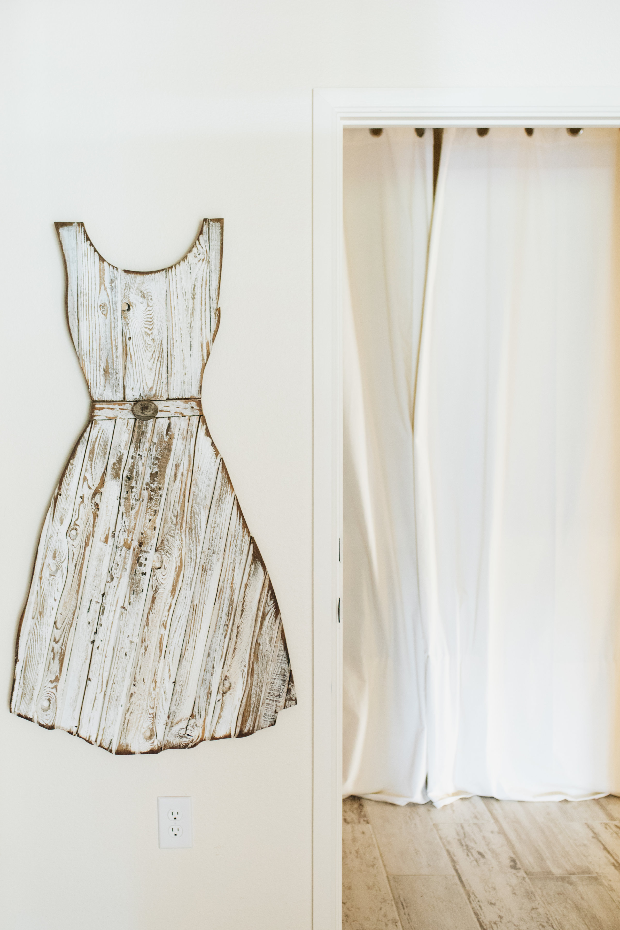 Doug Forrest Studio - Our friend Doug Forrest created the wooden dress hanging outside of the Guest Room in Boho. The piece complements the flooring and adds a feminine, handmade touch to its glam surroundings.