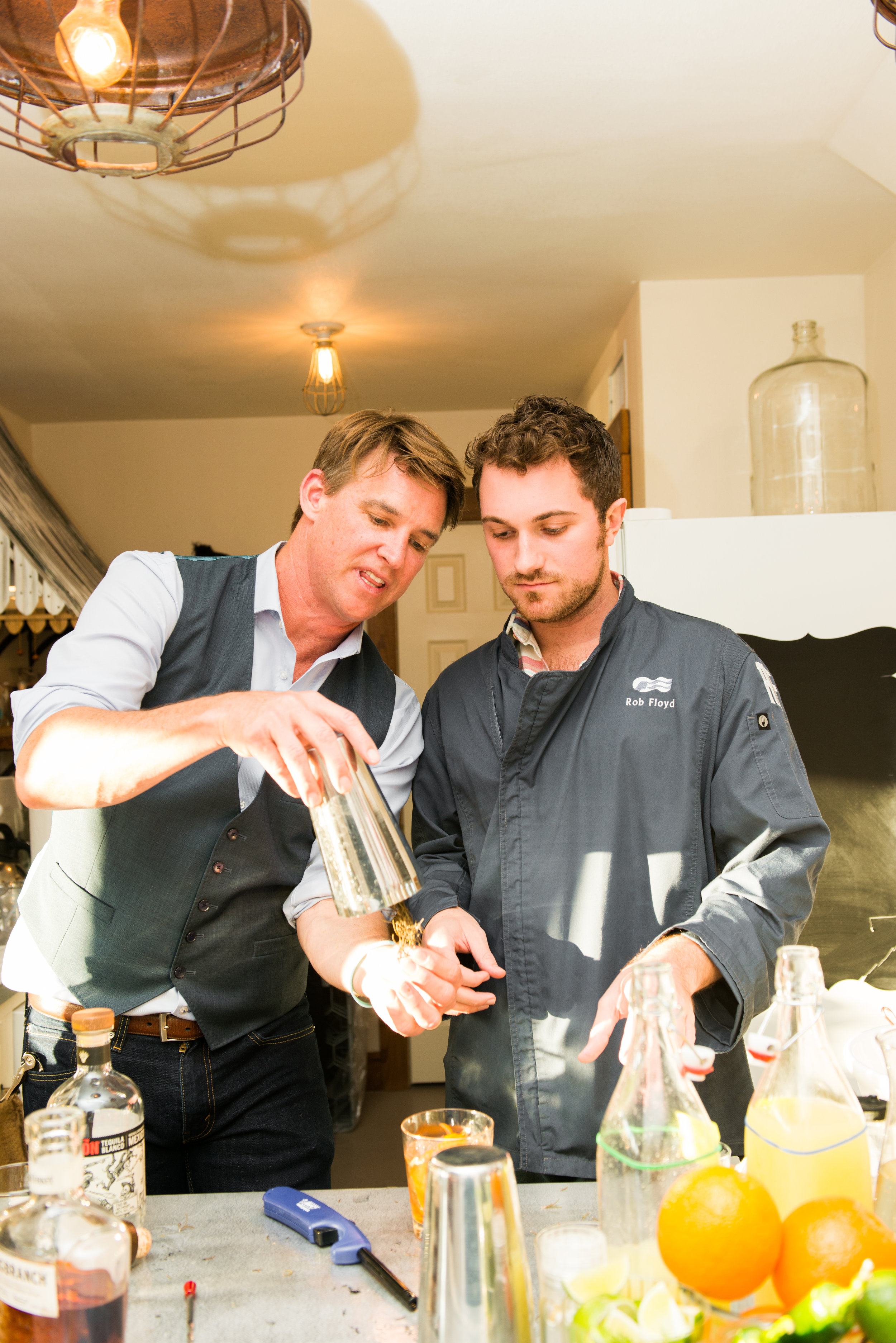 Rob Floyd and Shay Spence make a Smoking Gun cocktail at The Vintage Round Top x Women of Today welcome dinner.