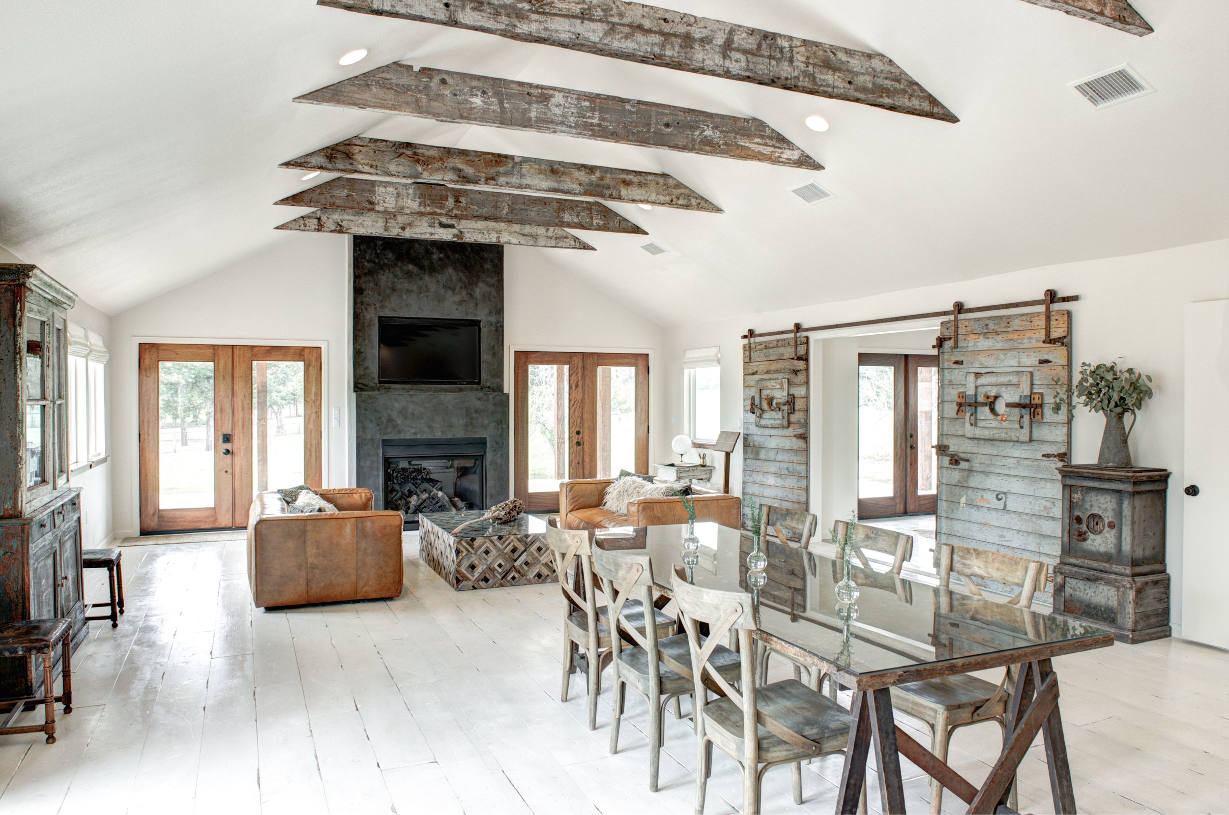 The 900-sq-ft Boho great room includes a gas fireplace and dining table for 8.