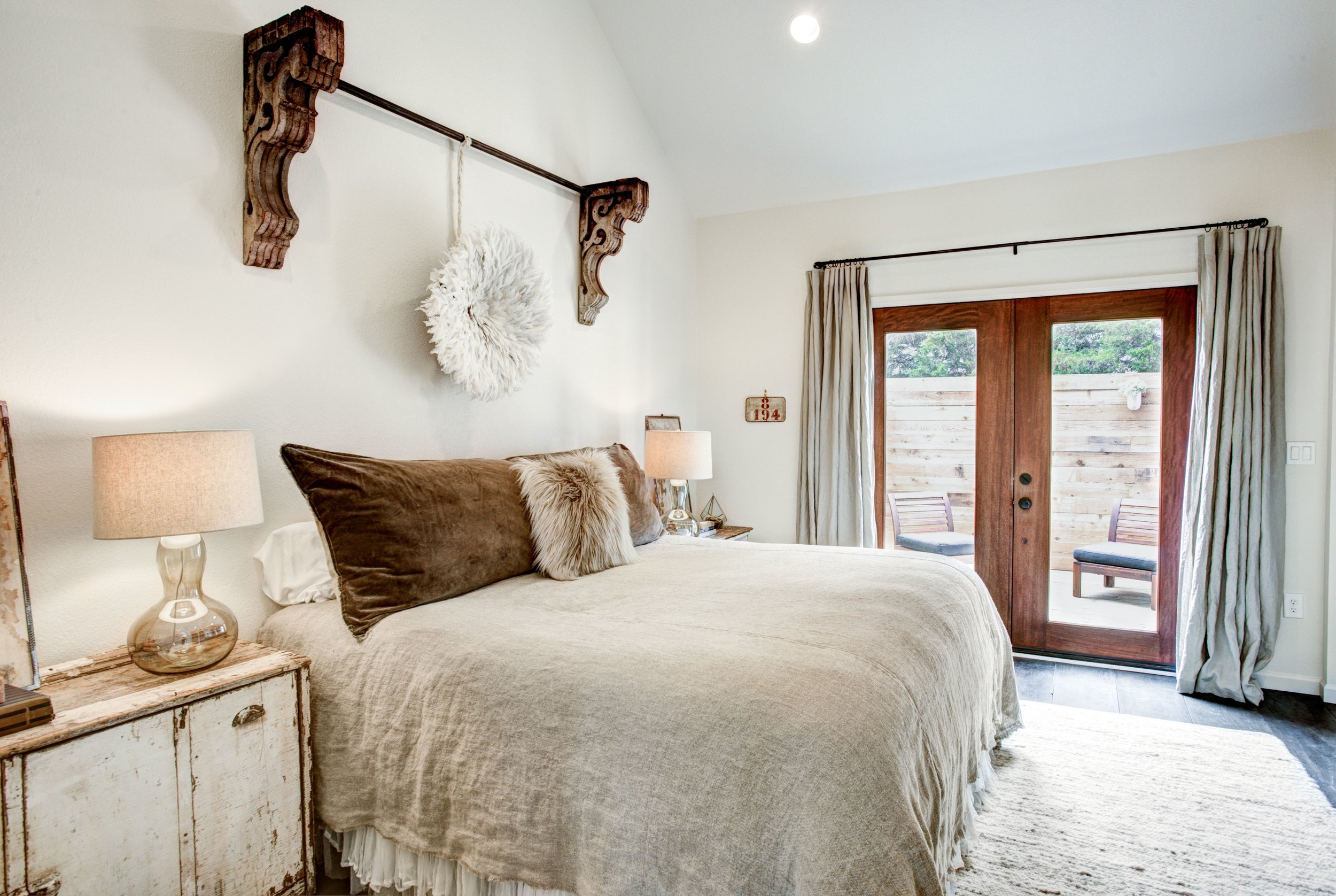 The Boho master bedroom features a king-sized bed, ensuite full bath with soaking tub and separate shower, and a private ensuite patio.