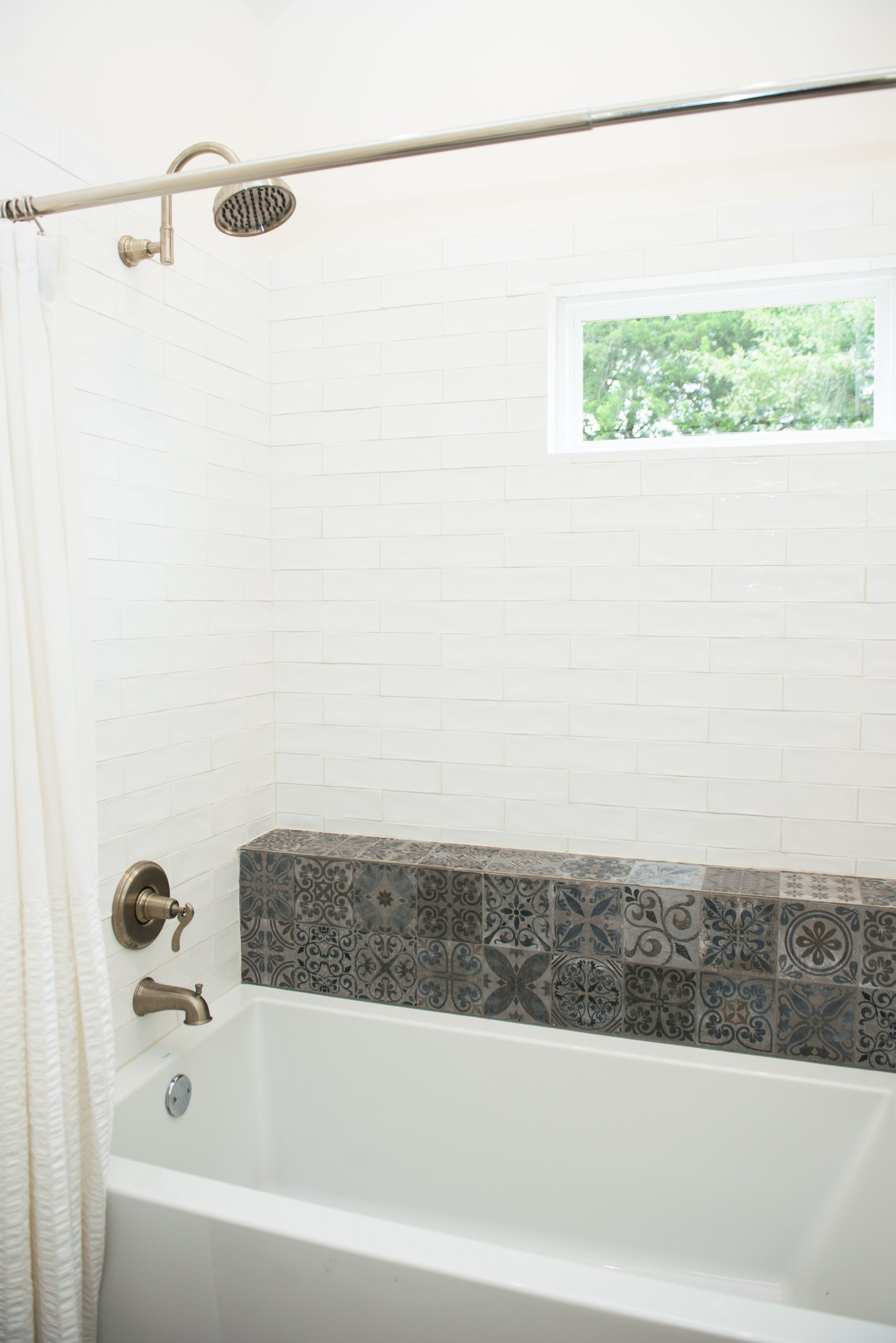 The Boho guest bedroom bath features a soaking tub and shower.
