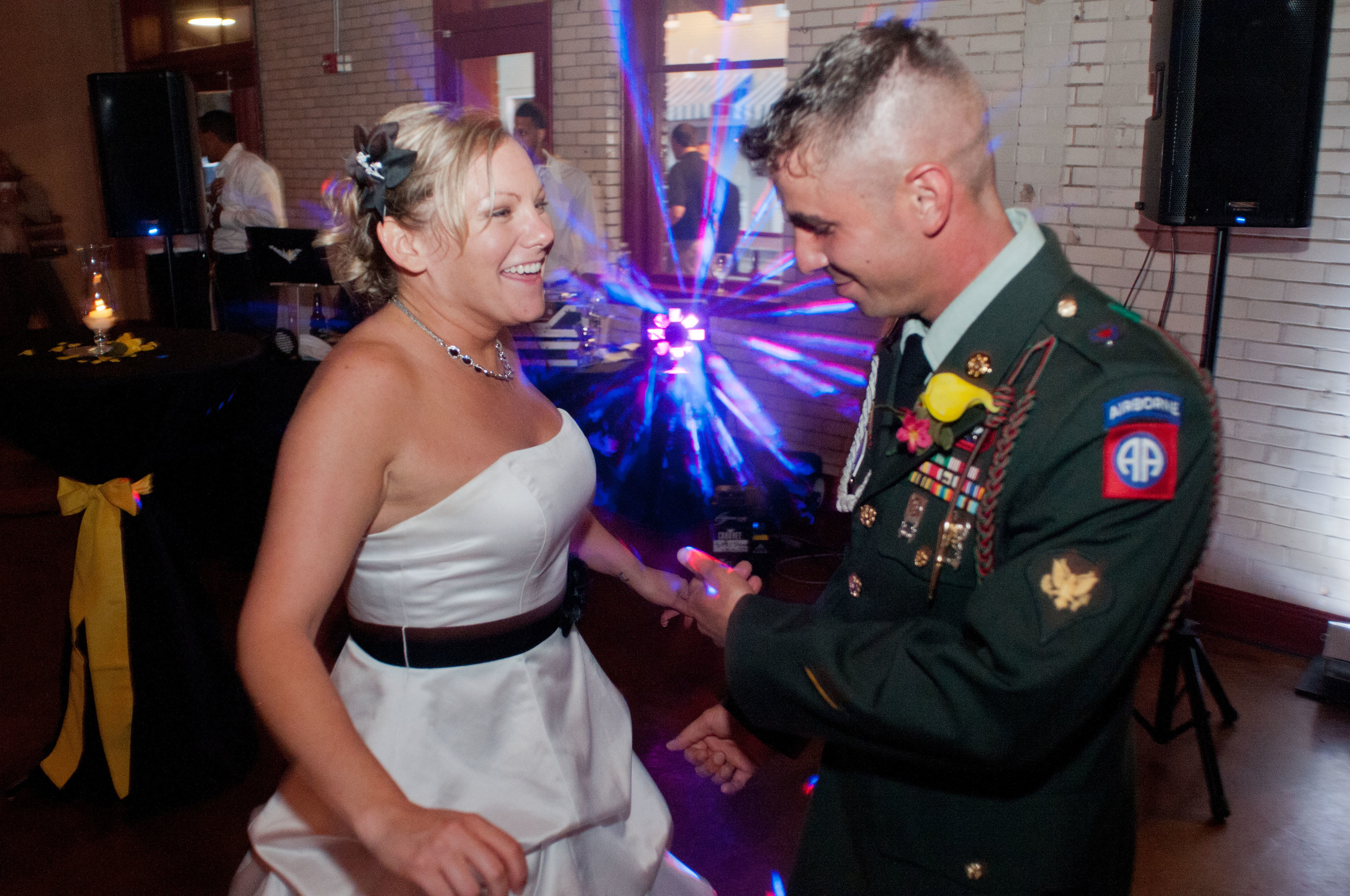 """""""Even my husband who does NOT dance was out on the dance floor having the time of his life!""""     In July of 2013, my husband and I had the celebration for the start of our lives together. Hiring a DJ for our wedding was a very important decision.Too many times, I have gone to weddings where the DJ was not very good, it really impacted the whole experience.   We decided to go with Star Struck Unlimited, specifically Lorenzo, because he has a grasp on how to read a crowd and play what the vibe is.     Lorenzo personally came to our house a few weeks before the wedding to discuss what we wanted for ceremony songs, reception songs, introductions, dance music, etc. He was able to obtain every song we wanted for not only our ceremony but also for the reception. It was perfect! Once the formalities of the reception were over, the dance party began. Lorenzo did exactly what he's known for – feeling the vibe of the crowd and playing what keeps people on the dance floor.   Even my husband who does NOT dance was out on the dance floor having the time of his life!   All our guests complimented how good our DJ was and what a great vibe there was! I'm sure every bride hears what a fantastic wedding they had, but with ours, I really feel that the music brought the fun on the dance floor and truly indicated what a great time it was. Lorenzo was such a big part of making our wedding the party we wanted it to be and he is still a close friend.    -Beth G."""