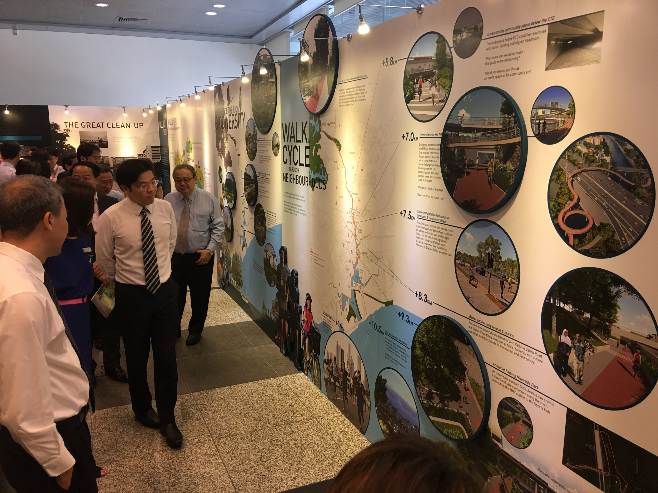Minister for National Development views exhibition at URA Centre