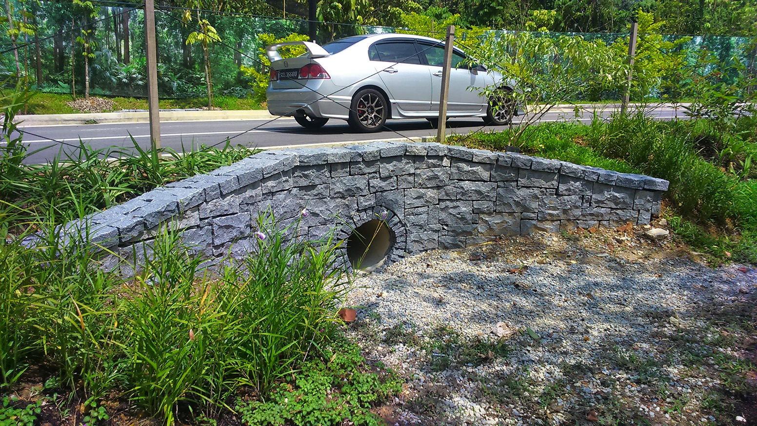 Stone clad culvert conveying water from the coach park area through to the wetland cell for treatment prior to discharge into the lower wetland lake