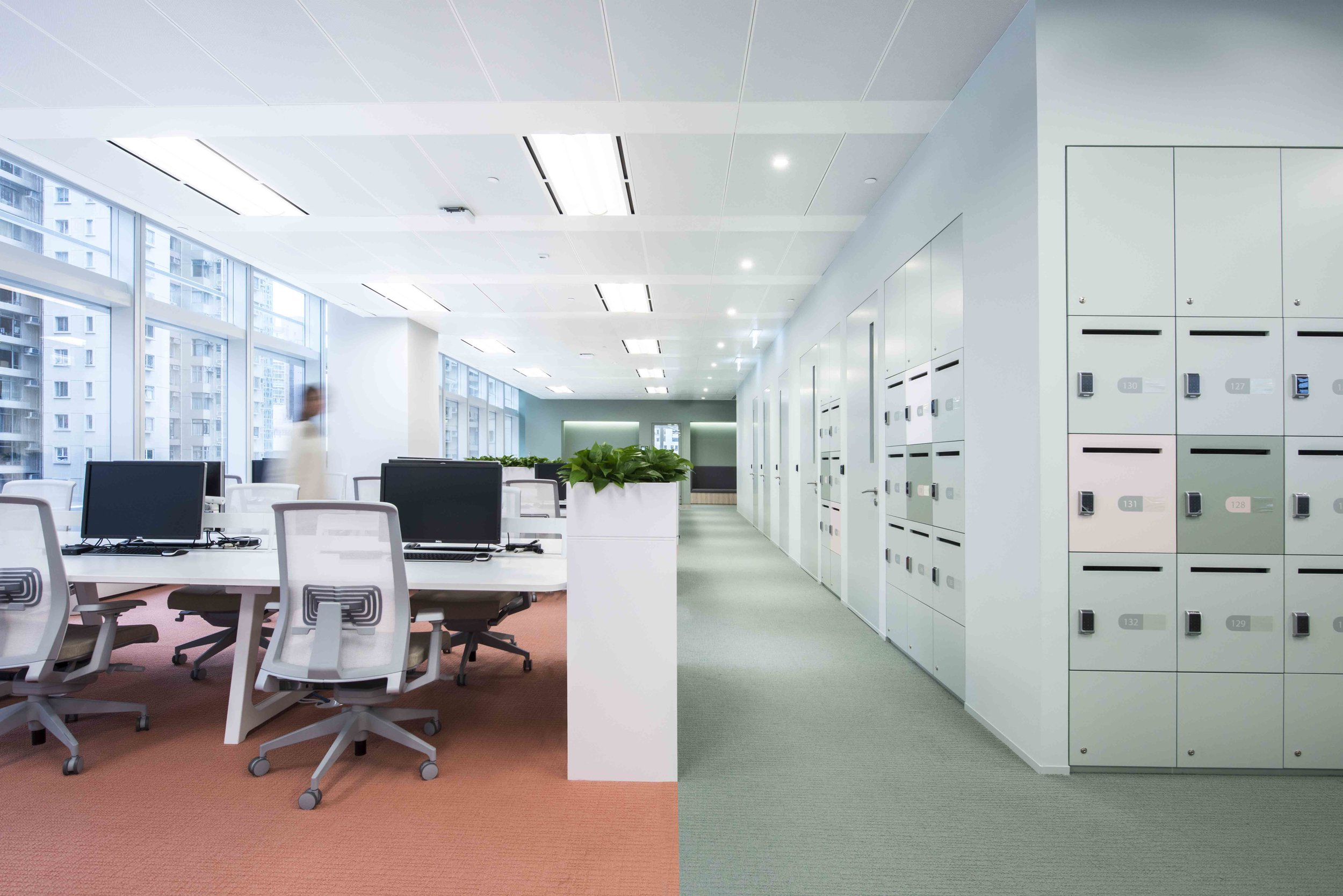The design responded to the brief by injecting an open plan environment with different zones of activities for socialising, informal collaborations, ergonomic workstation areas, formal private meeting rooms, and various acoustic booths for focused working. The open plan workspace is 100% flexible with a clean desk policy, where employees can use the personal lockers provided in the 'pill' like architectural volumes that form the back drop of the workspace.