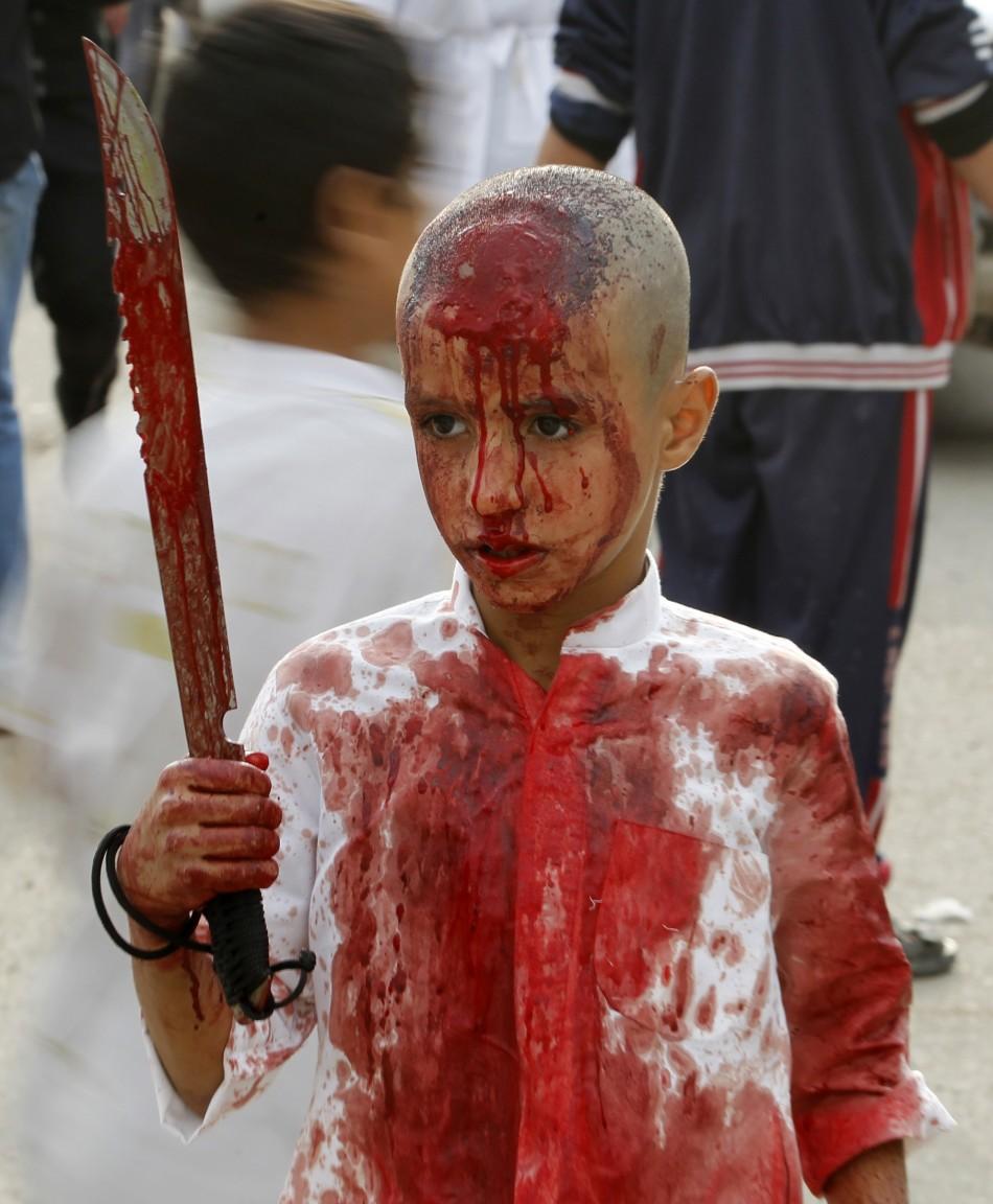 iraqi-shiite-muslim-child-gashes-his-forehead-sword.jpg