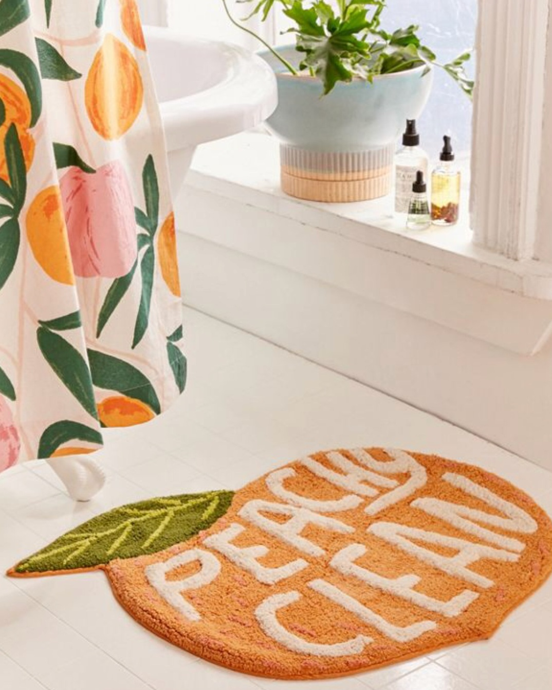 - If you follow me on Instagram stories you'll know I'm slowly (we've only lived there a year and a half- hah) making our house a home. I'm loving the idea of a bright and fun bathroom for Caroline and I think this bath mat is perfect! How fun, right?Find it here.