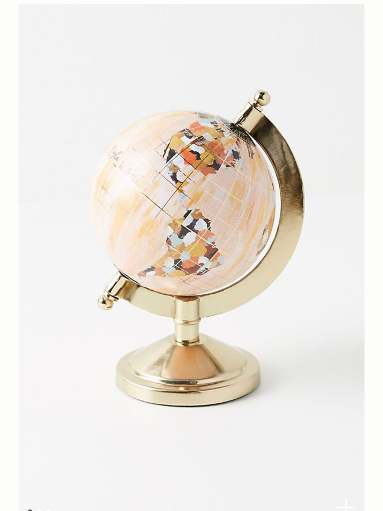 - Loving this globe! How pretty!Find it here.