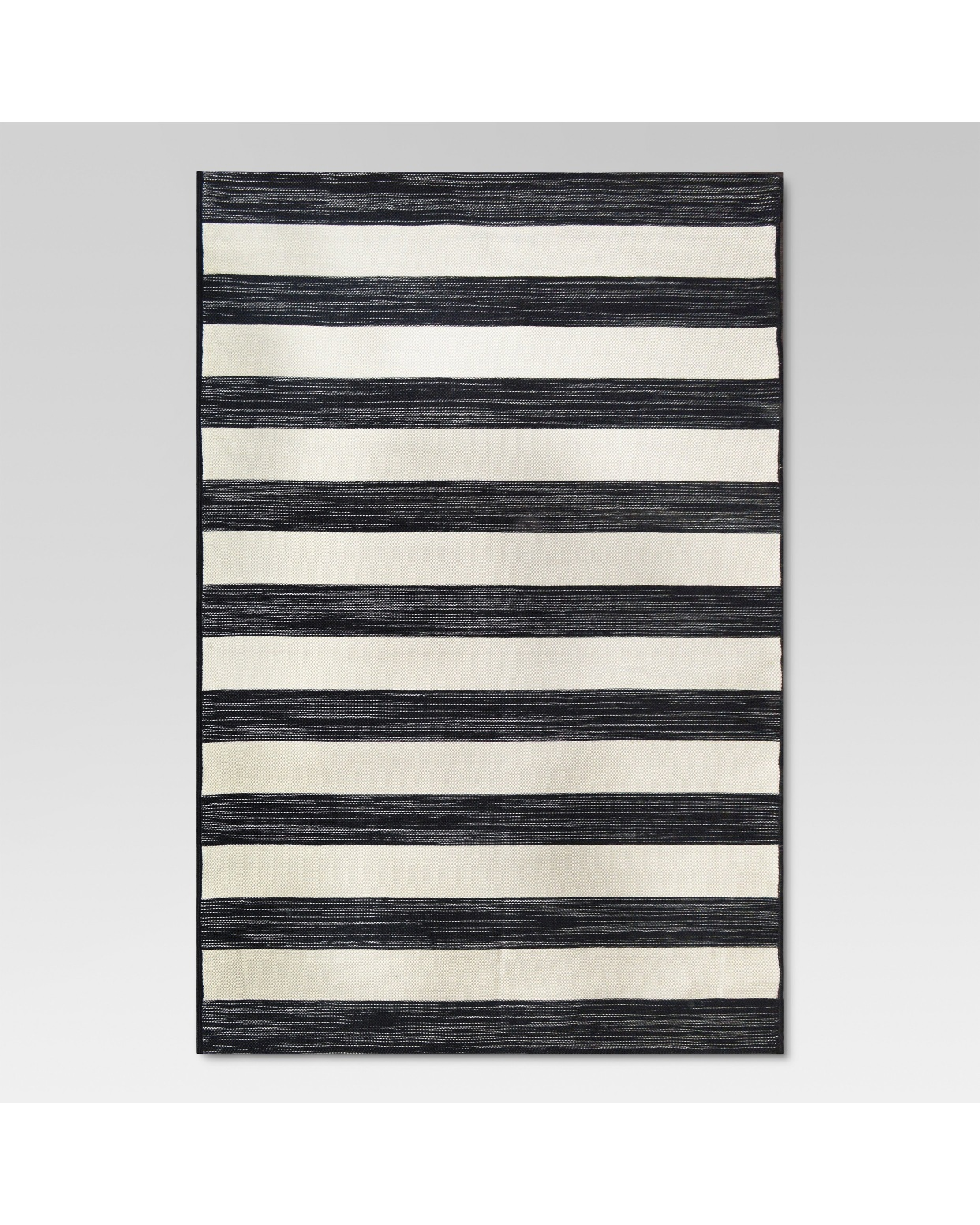 - Give me all the outdoor rugs. This one is perfect.Find it here.