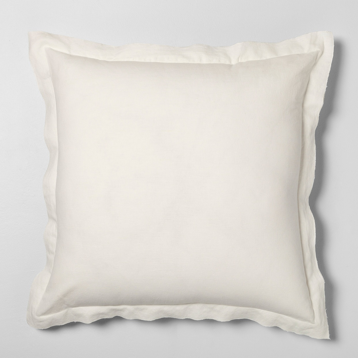 - Crisp white and cozy. The perfect new addition to our family room for summer!Find it here.