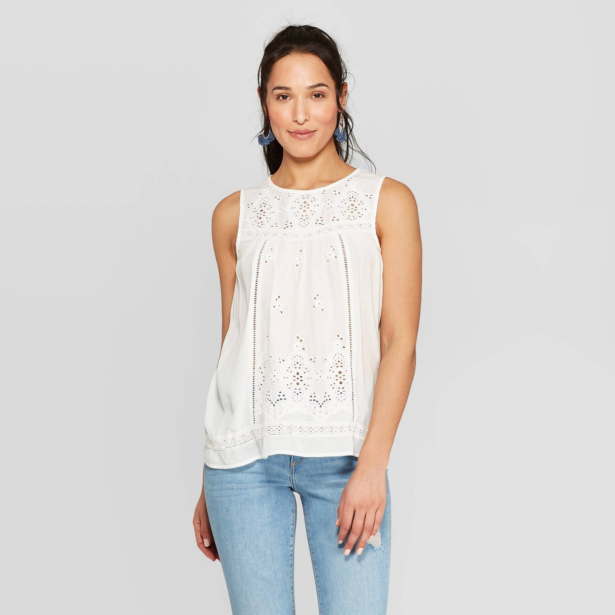 - A classic white eyelet top! The back is stretchy jersey material I love the design of the front.Find it here.
